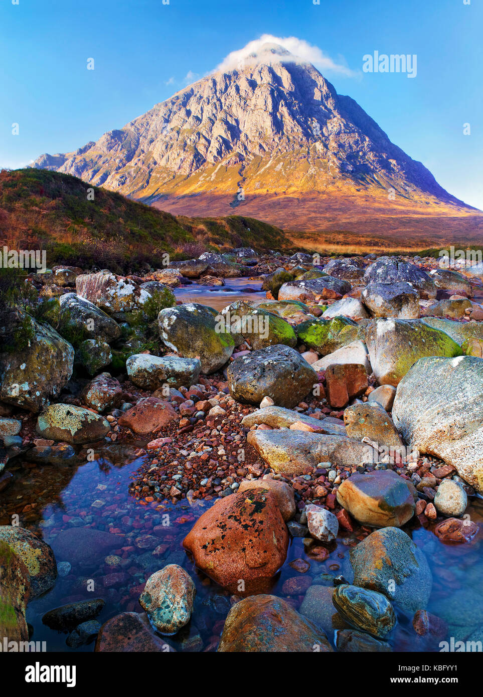A sunny view of the famous mountain Buachaille Etive Mor in Rannoch Moor in the Scottish Highlands - Stock Image