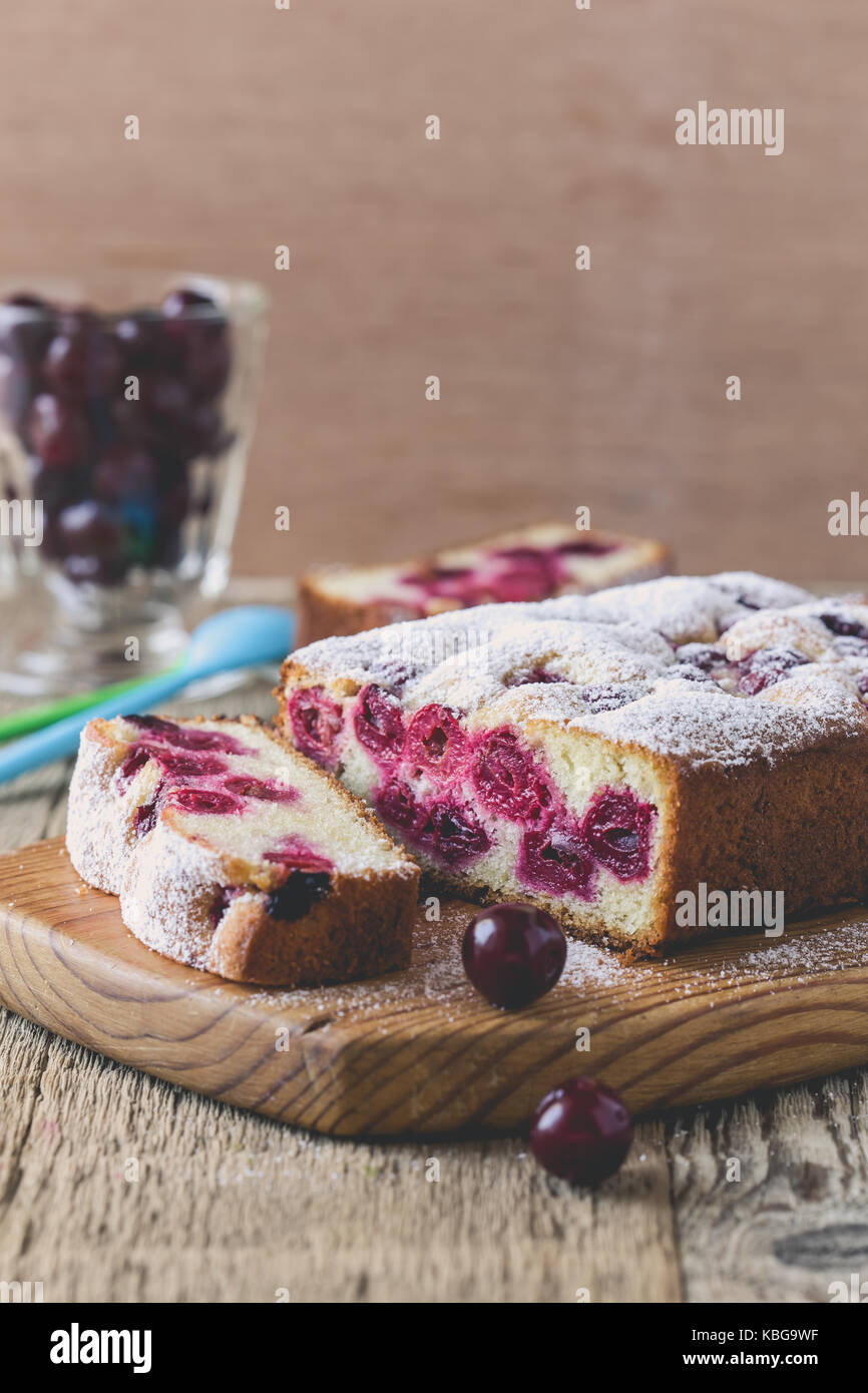 Homemade cherry cake on rustic wooden table Stock Photo