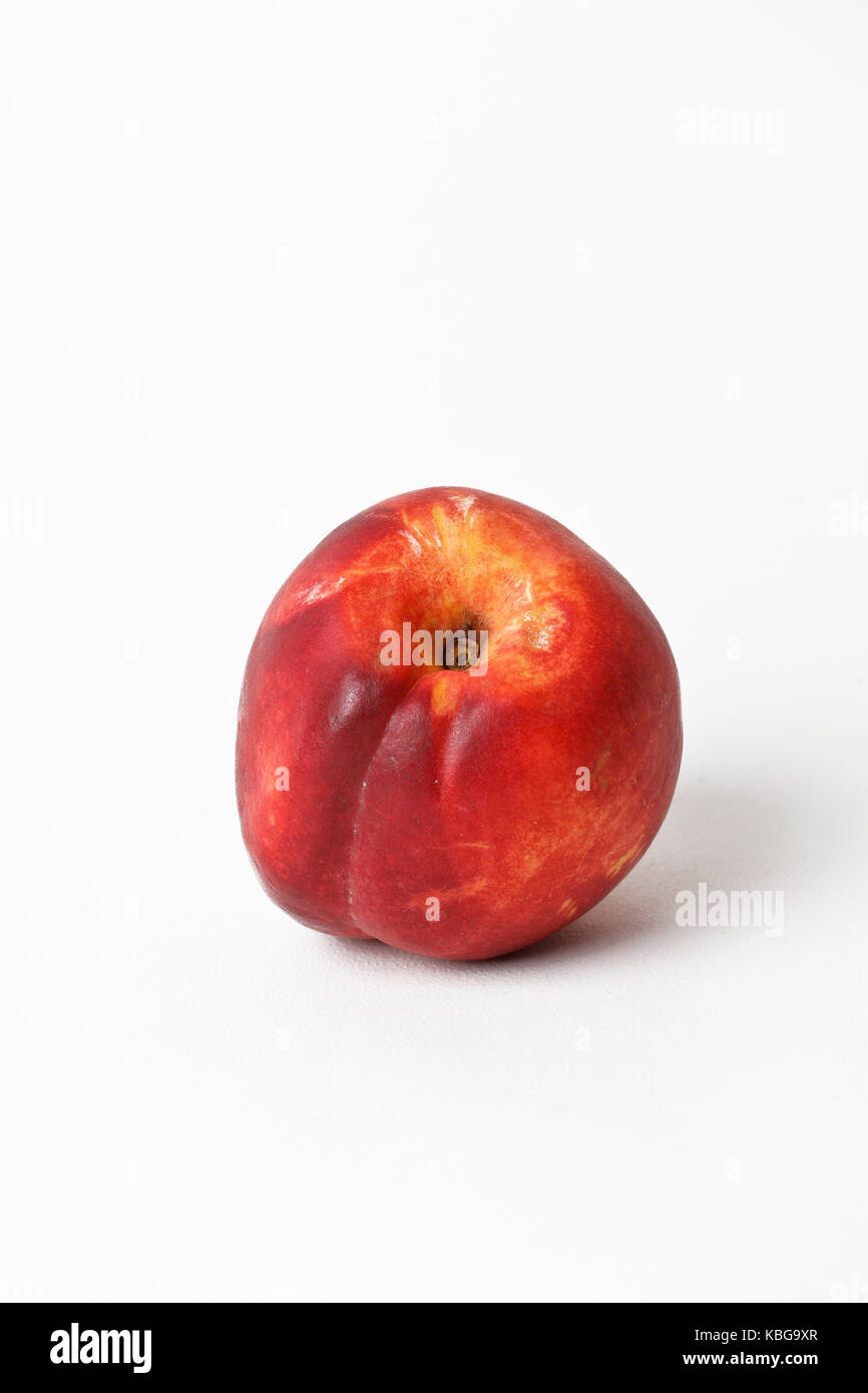 Nectarine on white background. Cut out - Stock Image