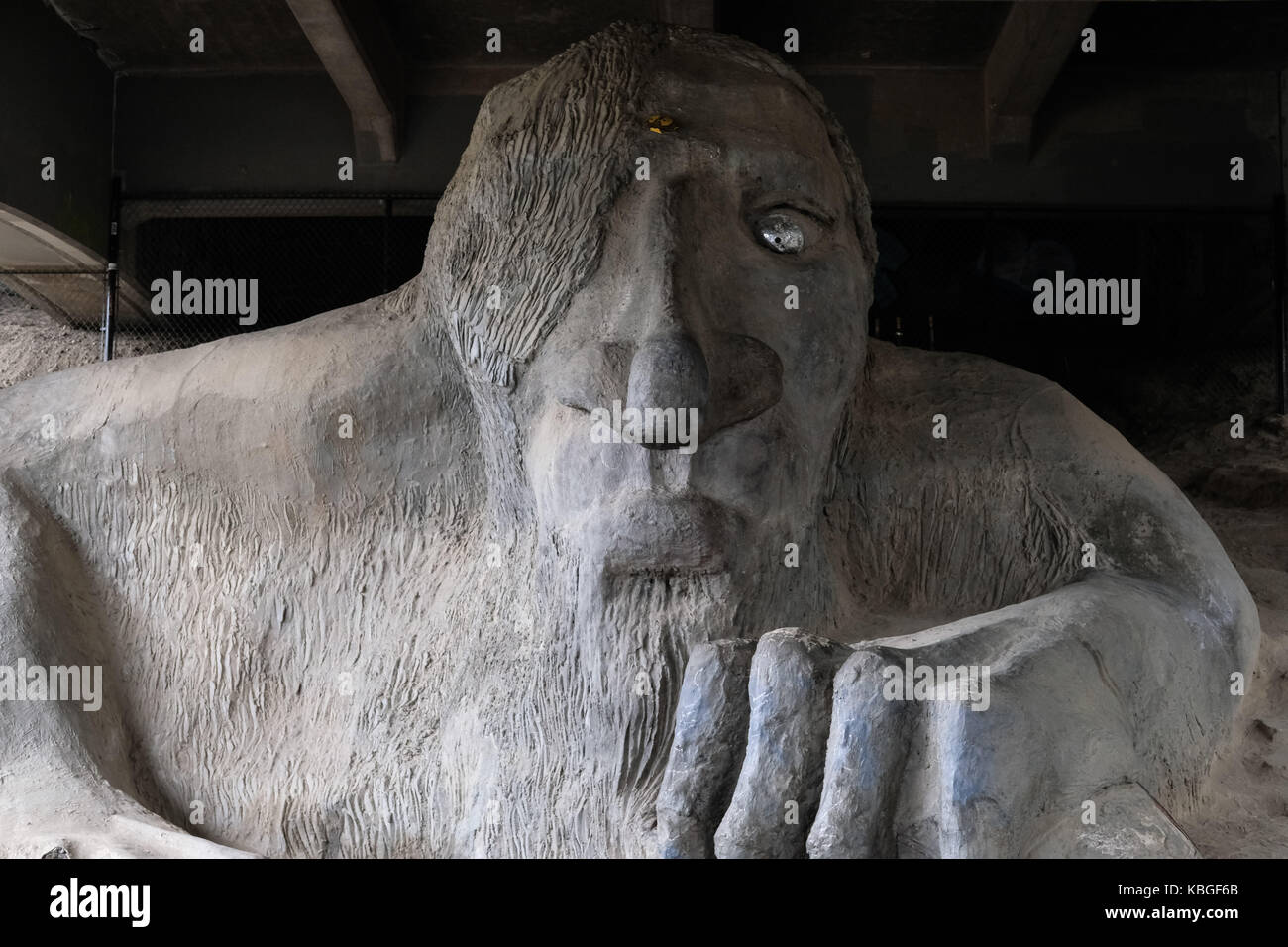 The Fremont Troll which sits under the Fremont Bridge in the Fremont area of Seattle, Washington, USA. - Stock Image