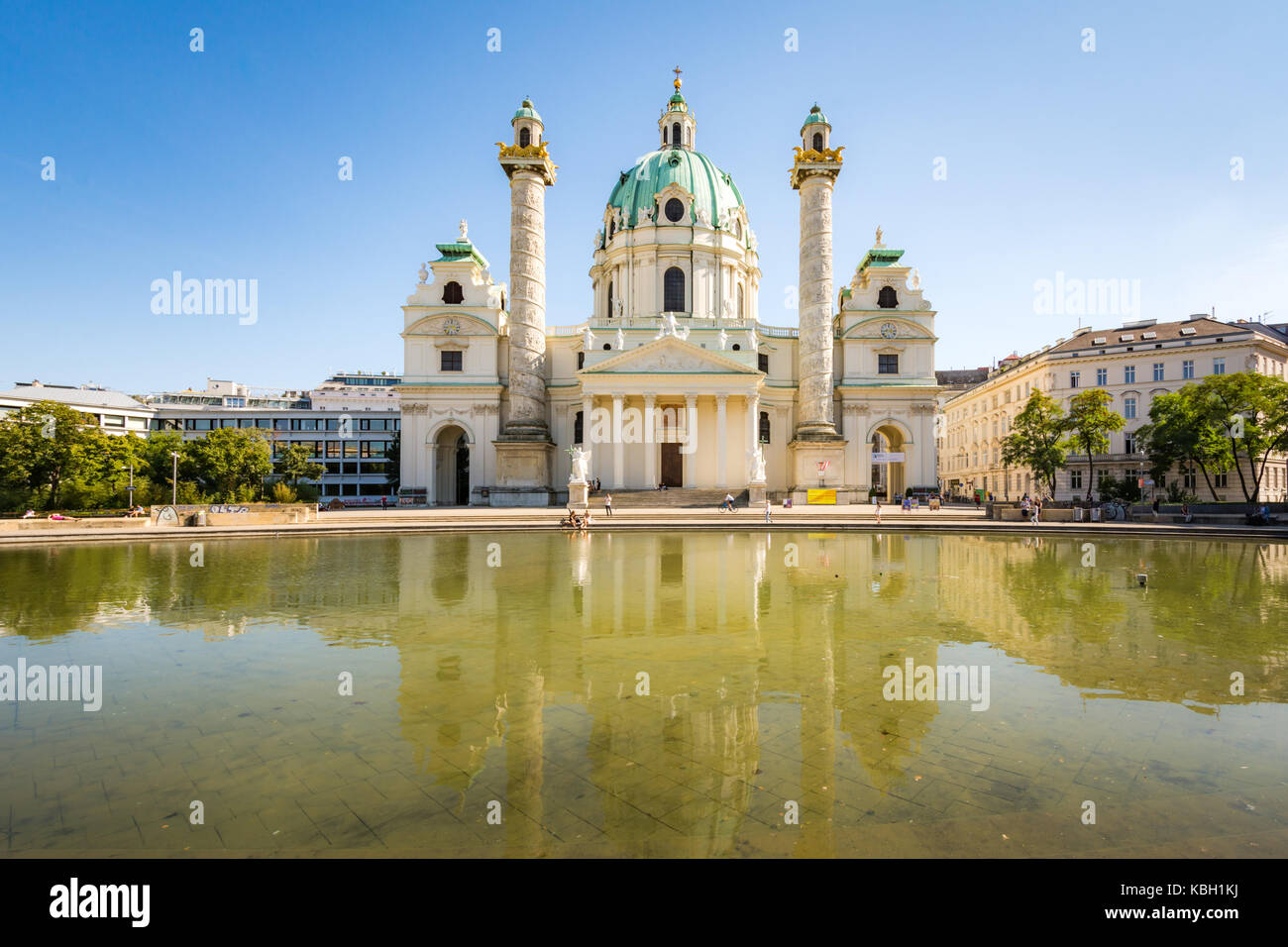 VIENNA, AUSTRIA - AUGUST 29: Tourists at the Baroque Karlskirche in Vienna, Austria on August 29, 2017. The church - Stock Image