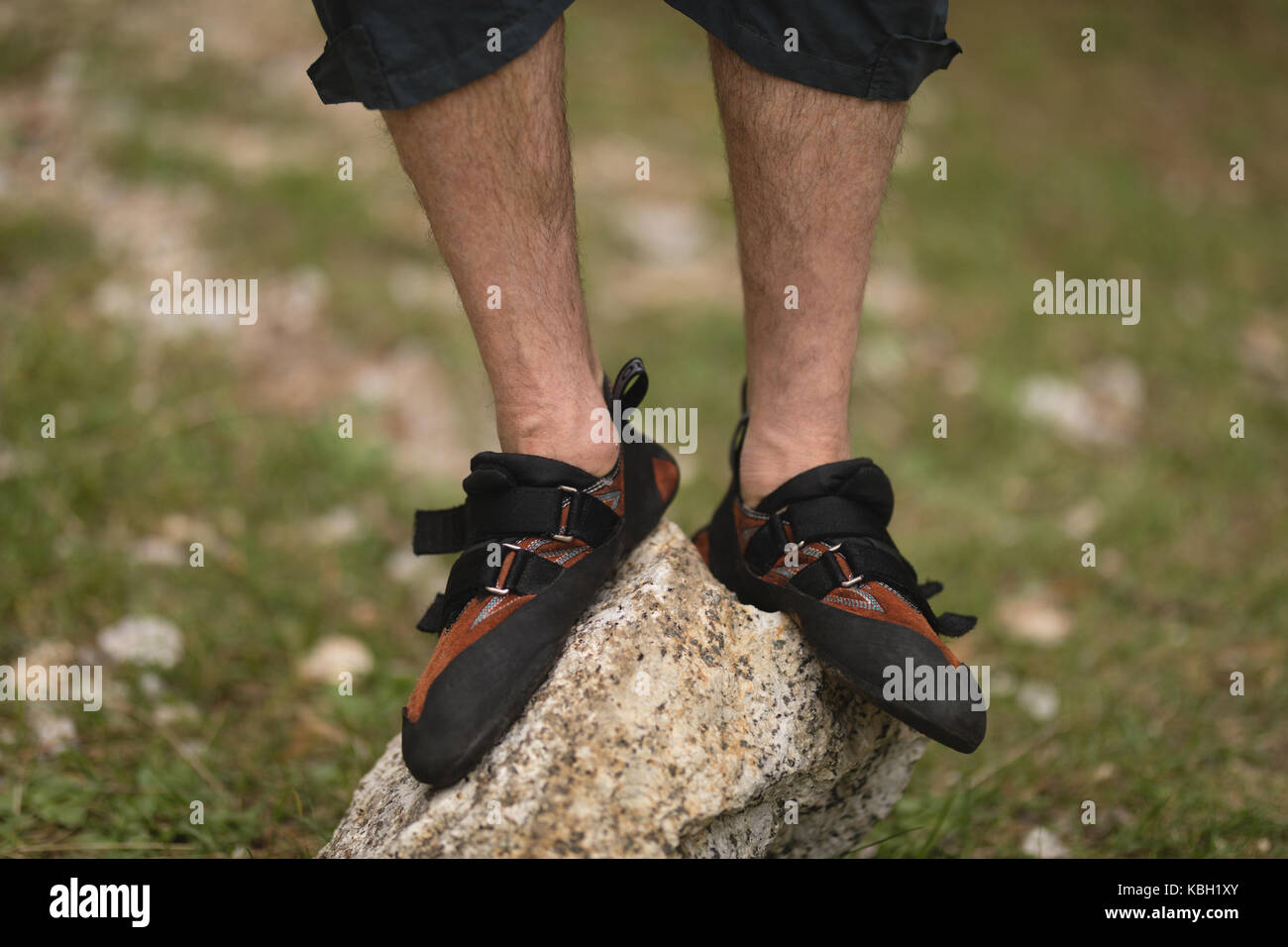 Low section of man standing on rock Stock Photo