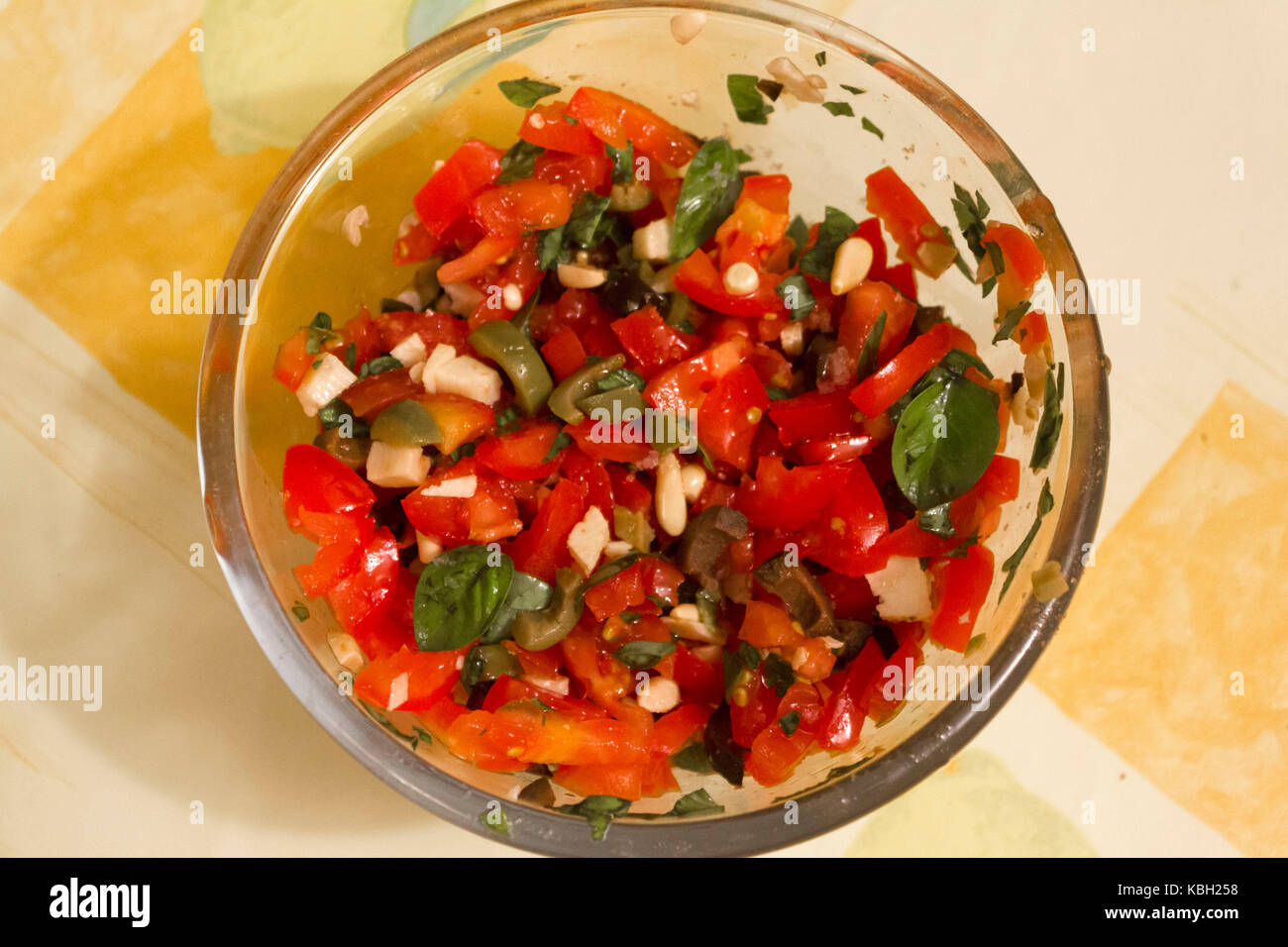 MASSA, ITALY - AUGUT 23 2015: fresh homemade sauce for pasta, vegetarian with pine nuts, tomatoes, basil and olives Stock Photo