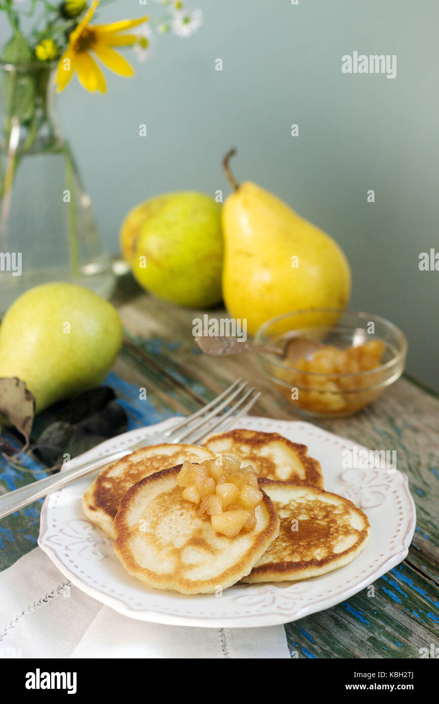 Pancake with pear compote, breakfast. Rustic style, selective focus. Stock Photo