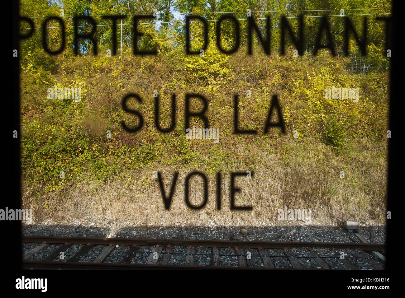 Writings on the window of a train's door, France - Stock Image