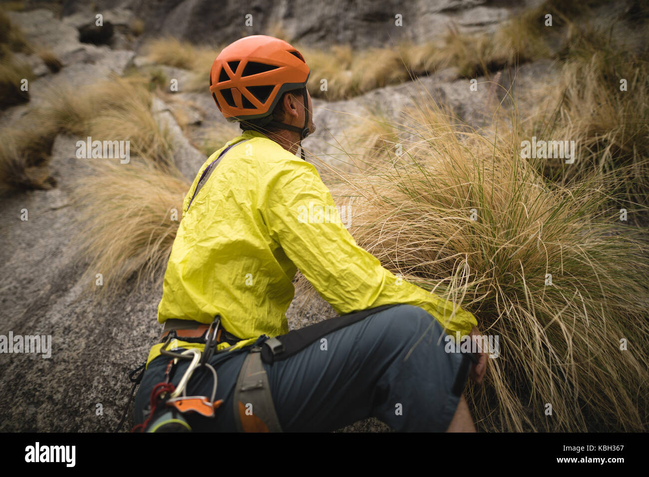 Thoughtful man preparing for mountaineering - Stock Image