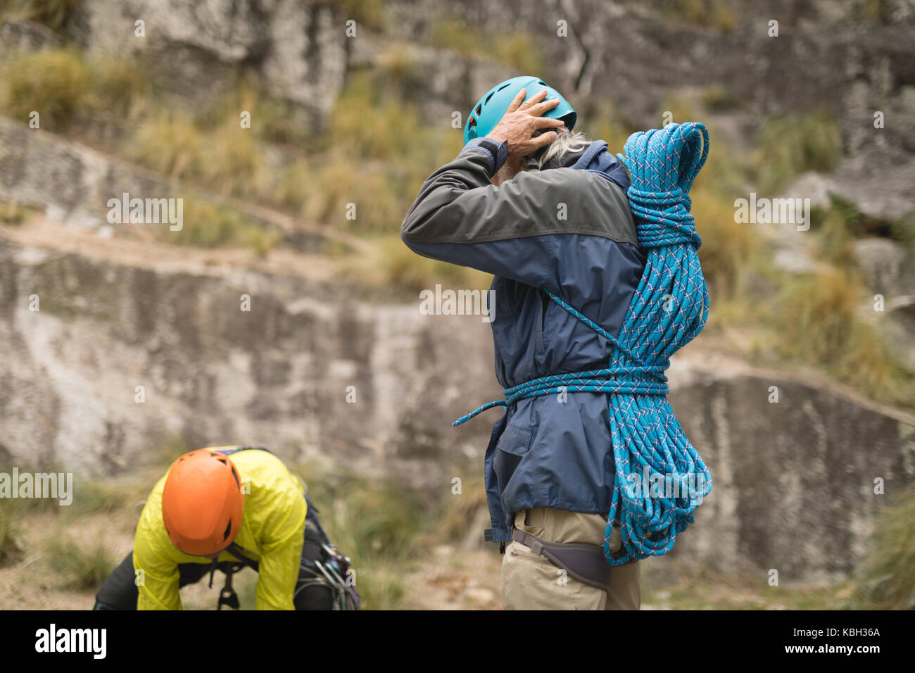 Determined friends preparing for mountaineering - Stock Image