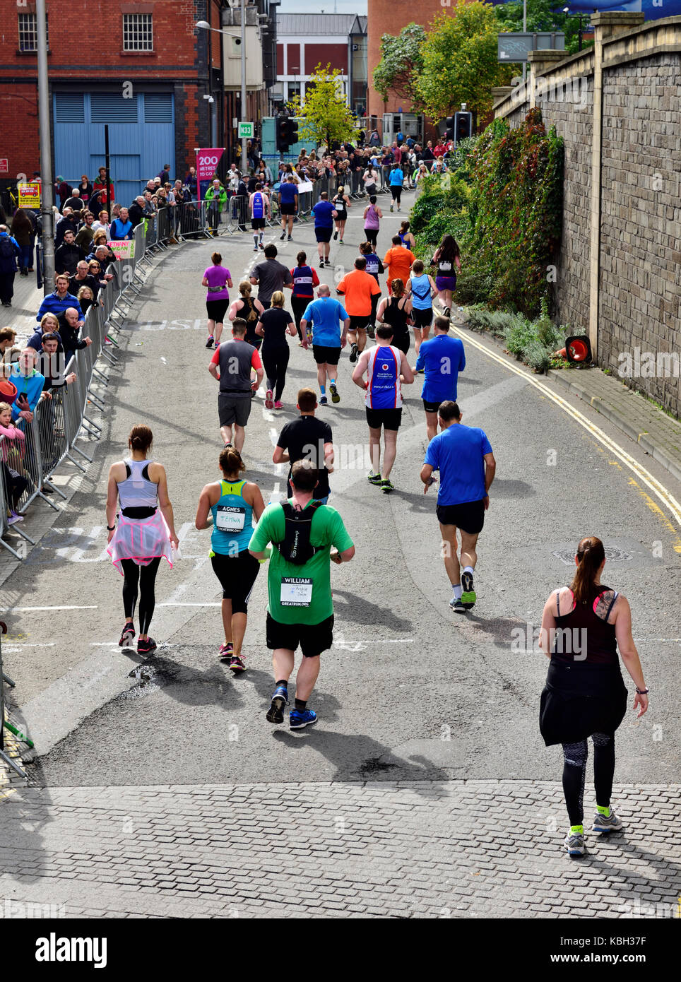 Runners in Simplyhealth half marathon race with crowd watching in the city centre of Bristol, UK - Stock Image