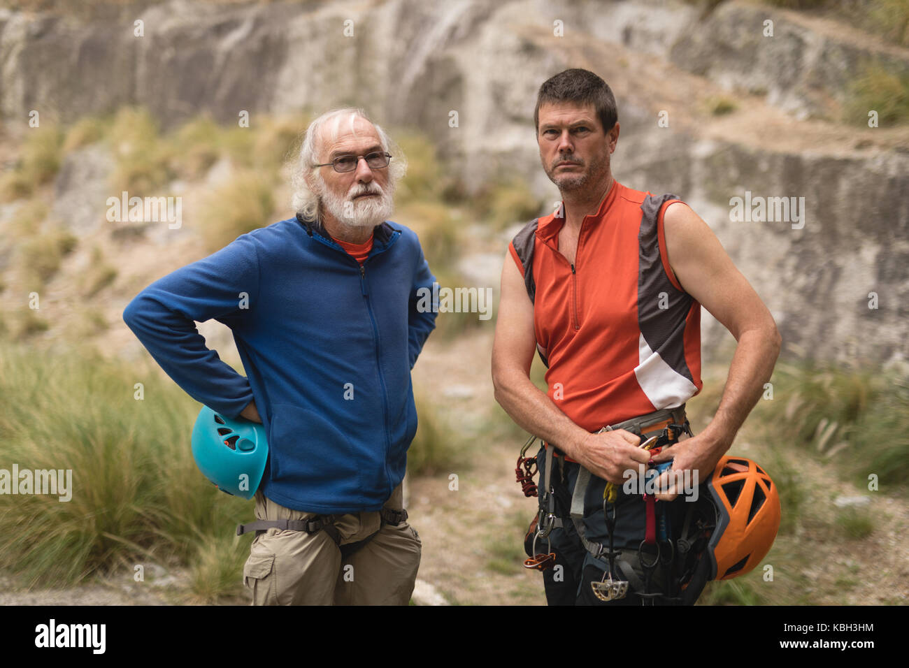Portrait of confident friends preparing for mountaineering - Stock Image