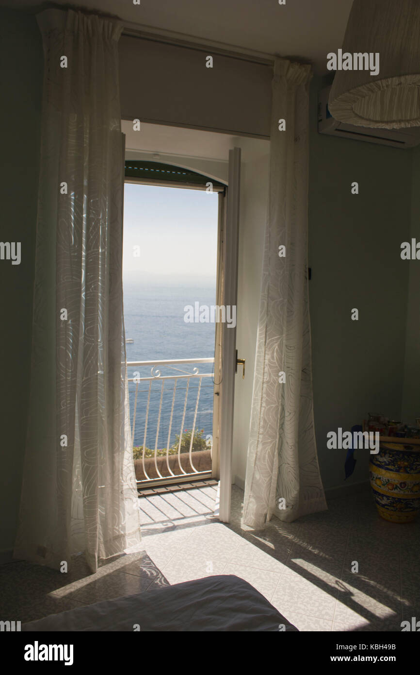 Amalfi, Italy, Augut 12 2014: Window facing the sea. A beautiful and relaxing frame to the world Stock Photo