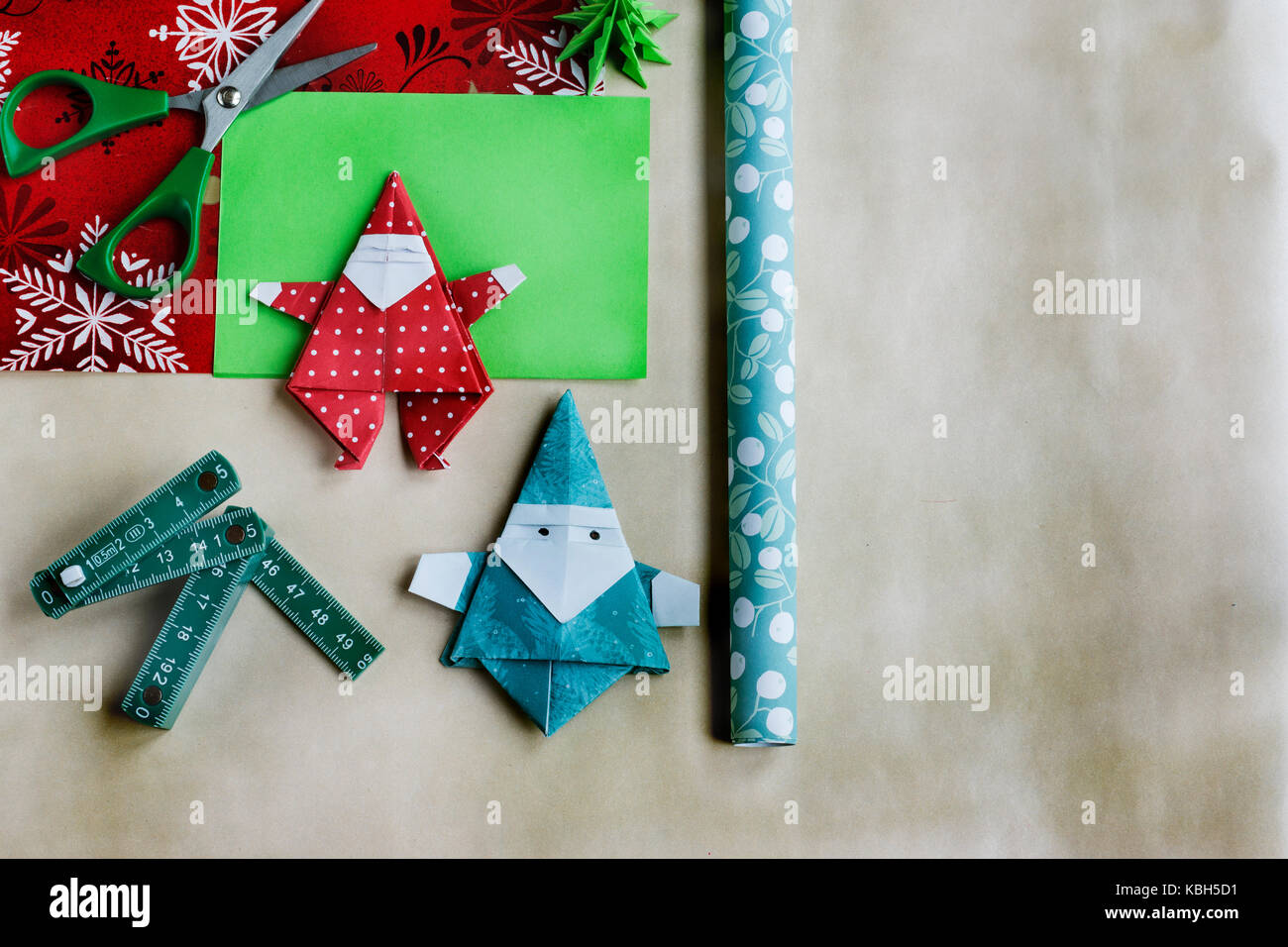 Overhead Of Handmade Origami Christmas Ornaments And Ribbon