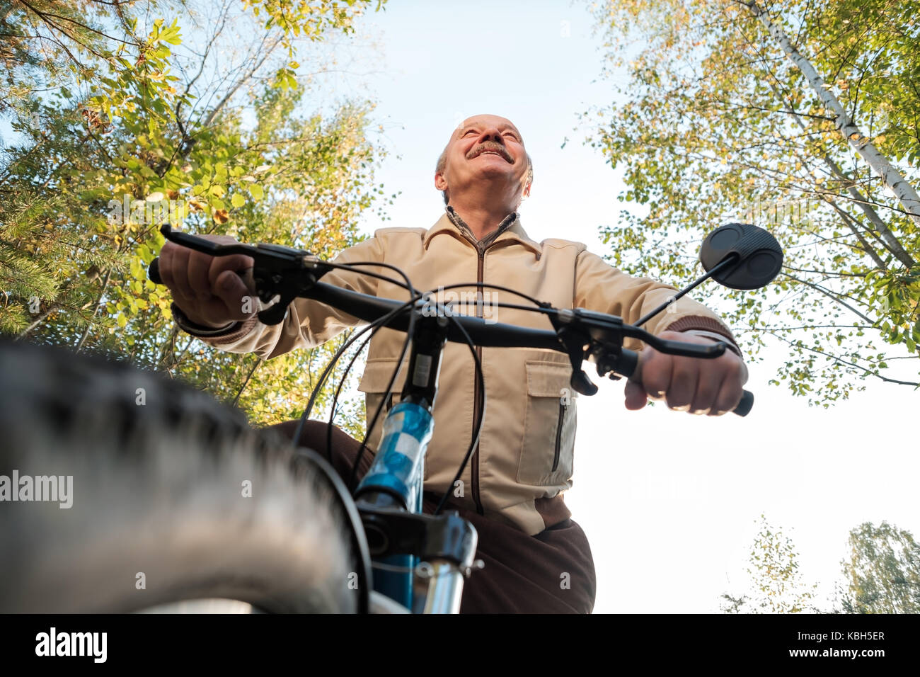 Senior man on cycle ride in countryside - Stock Image
