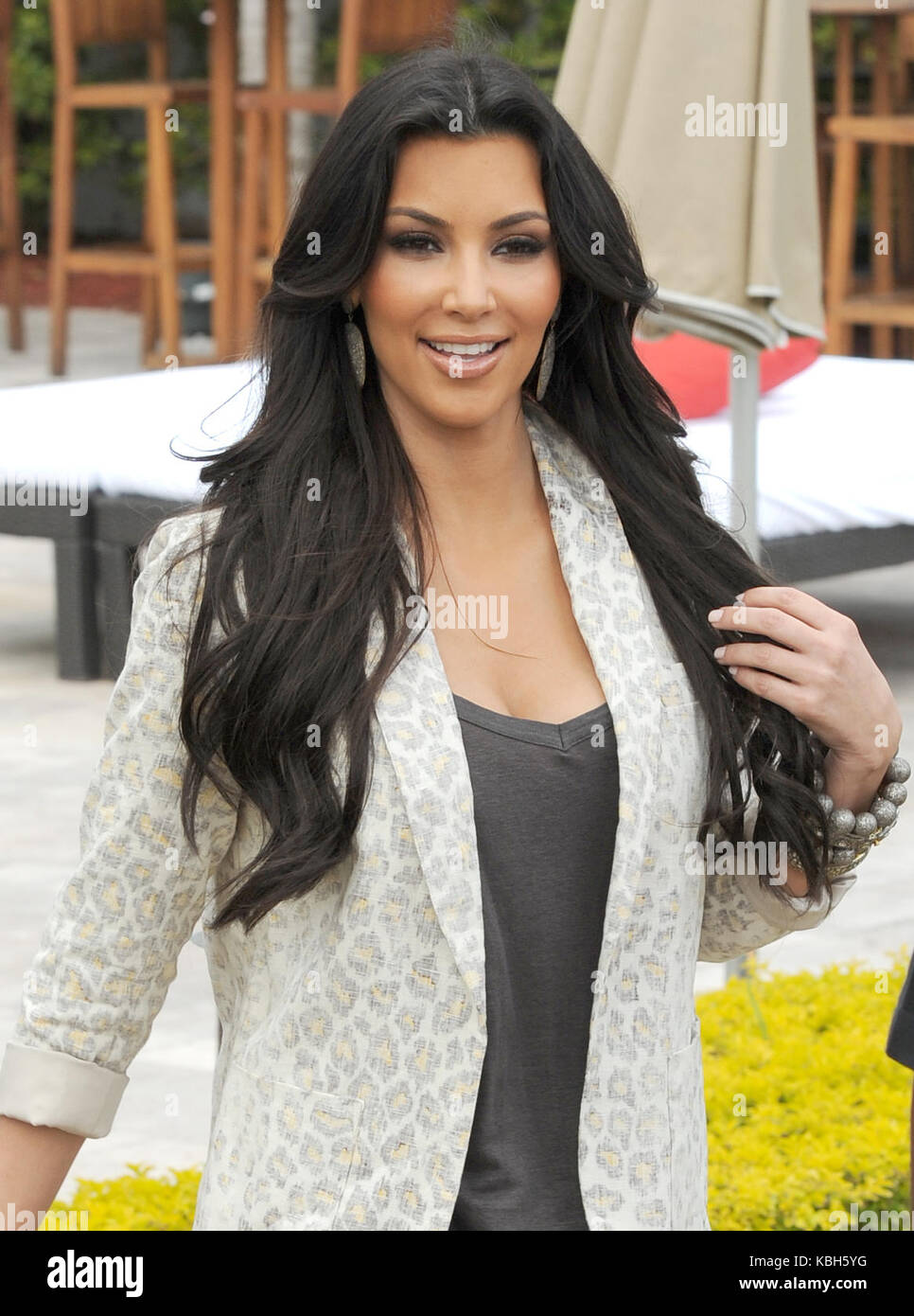 MIAMI BEACH, FL - MARCH 24: Kim Kardashian and Reggie Bush