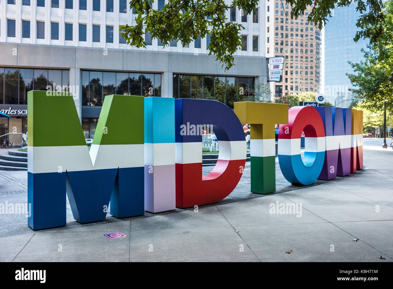 Colorful Midtown signage along Peachtree Street in Midtown Atlanta, Georgia at Colony Square in the Arts District. - Stock Image