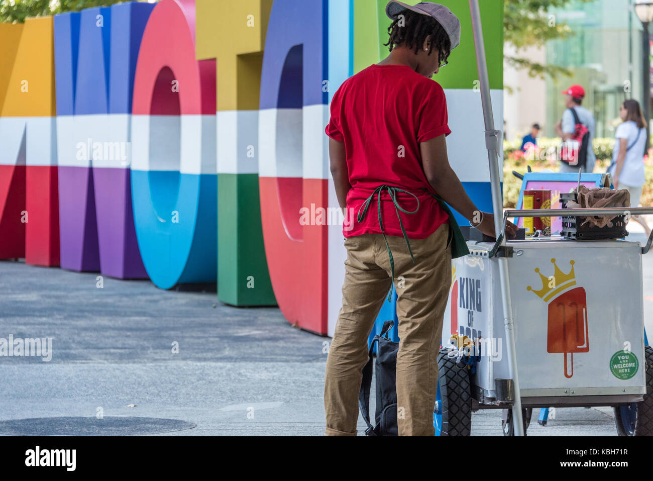 King of Pops popsicle vendor on Peachtree Street in Atlanta, Georgia next to colorful Midtown signage at Colony - Stock Image