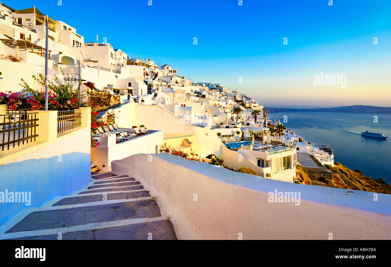 Streets of Fira, Santorini island, Greece. Traditional and famous white houses over the Caldera, Aegean sea. - Stock Image