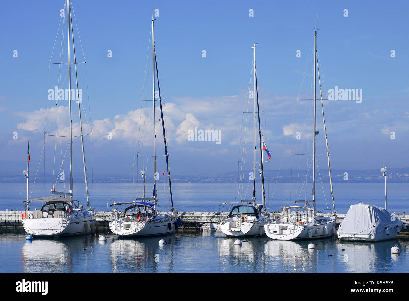 Sailboats lay at quay in the pleasance harbor of Evian-les-BAins, Savoie, France Stock Photo