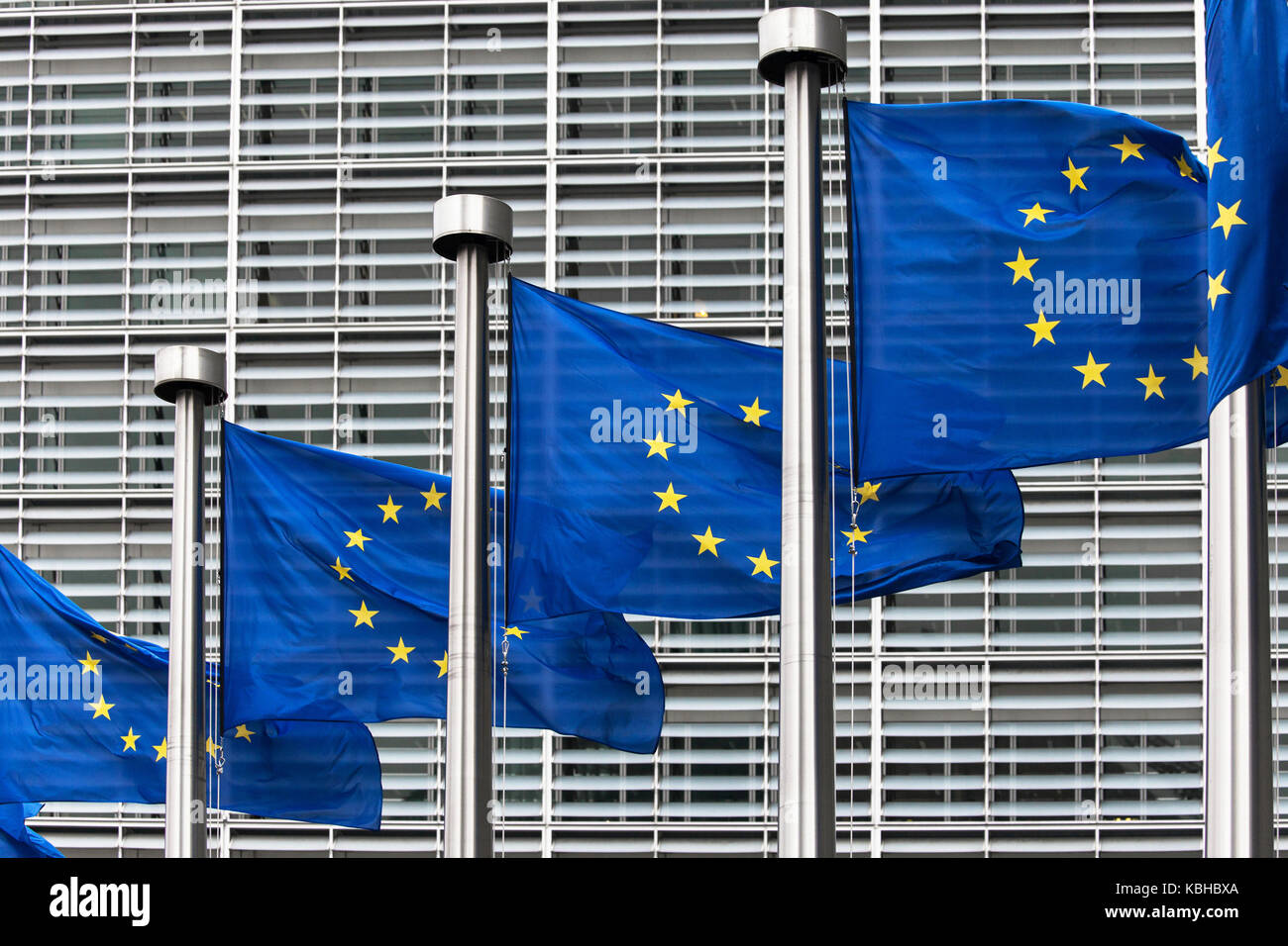 Flags of the European Union in front of the Berlaymont building in Brussels, Belgium. Stock Photo