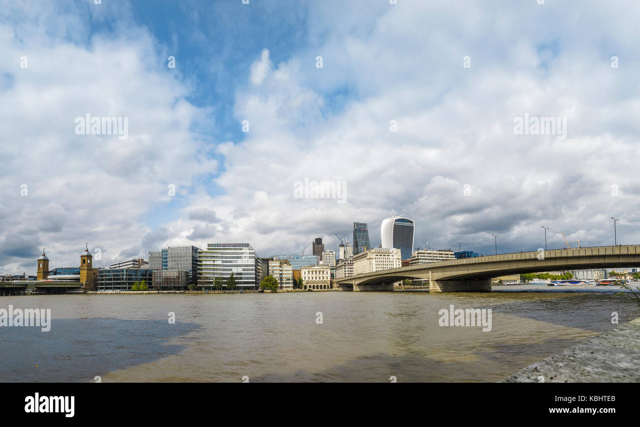 Panoramic view: River Thames north bank to the City of London by London Bridge - Walkie Talkie, Cheesegrater, Adelaide Stock Photo