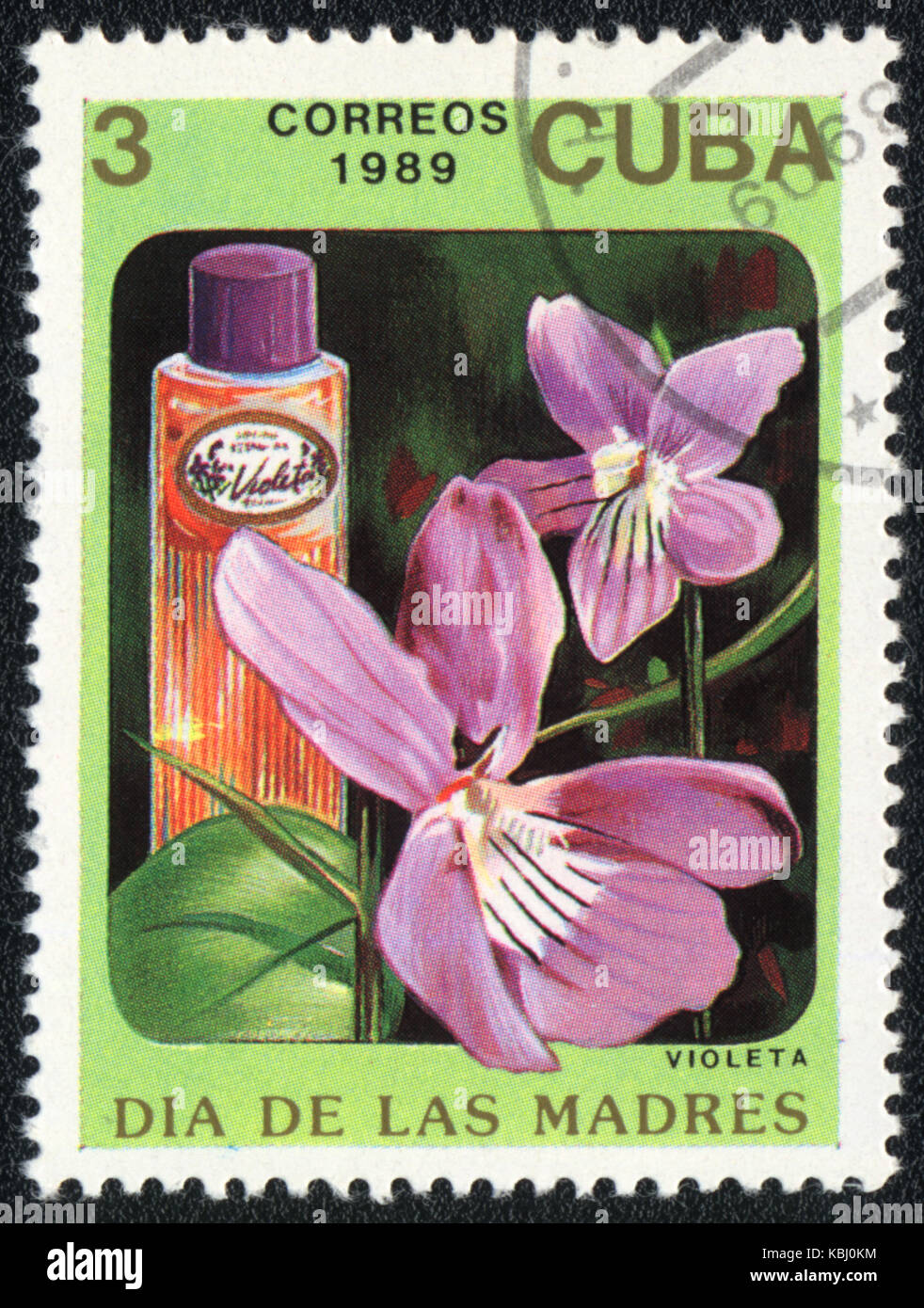 A stamp printed in CUBA shows a Bottle of violeta perfume , circa 1989 - Stock Image