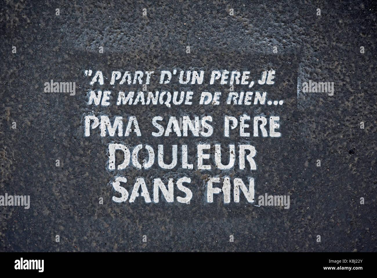 'PMA Sans pere' stencil on a pavement in Paris, France. - Stock Image