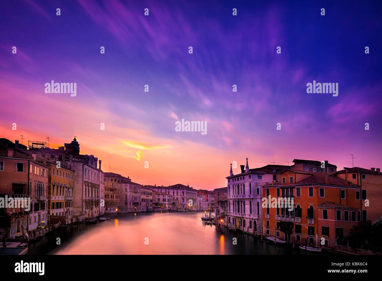Long exposure of dramatic skies at sunset over Venice, Italy seen from the Accademia Bridge - Stock Image