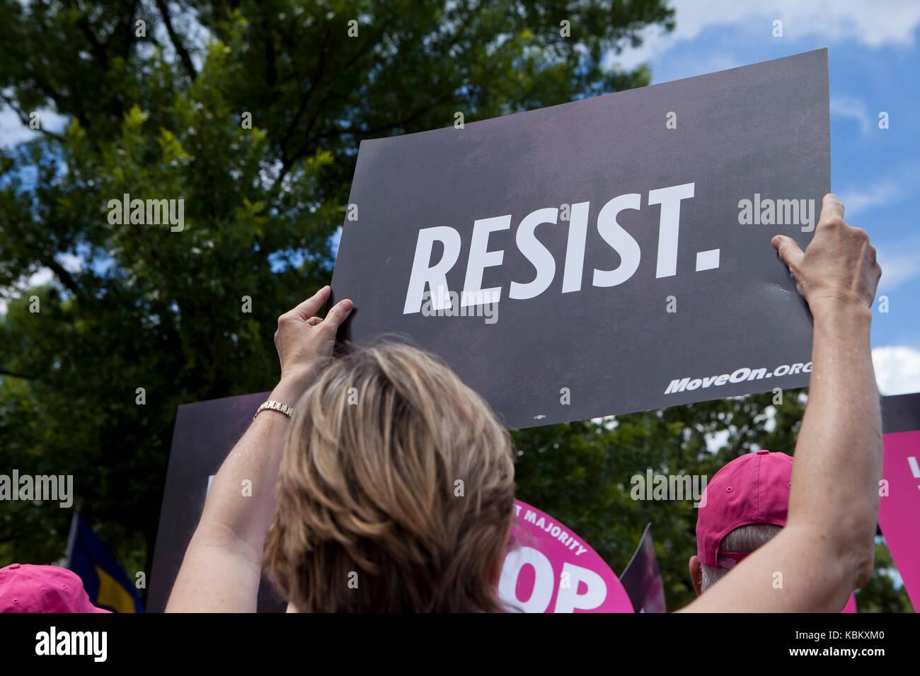 Woman holding RESIST sign at a progressive healthcare protest rally - Washington, DC USA - Stock Image