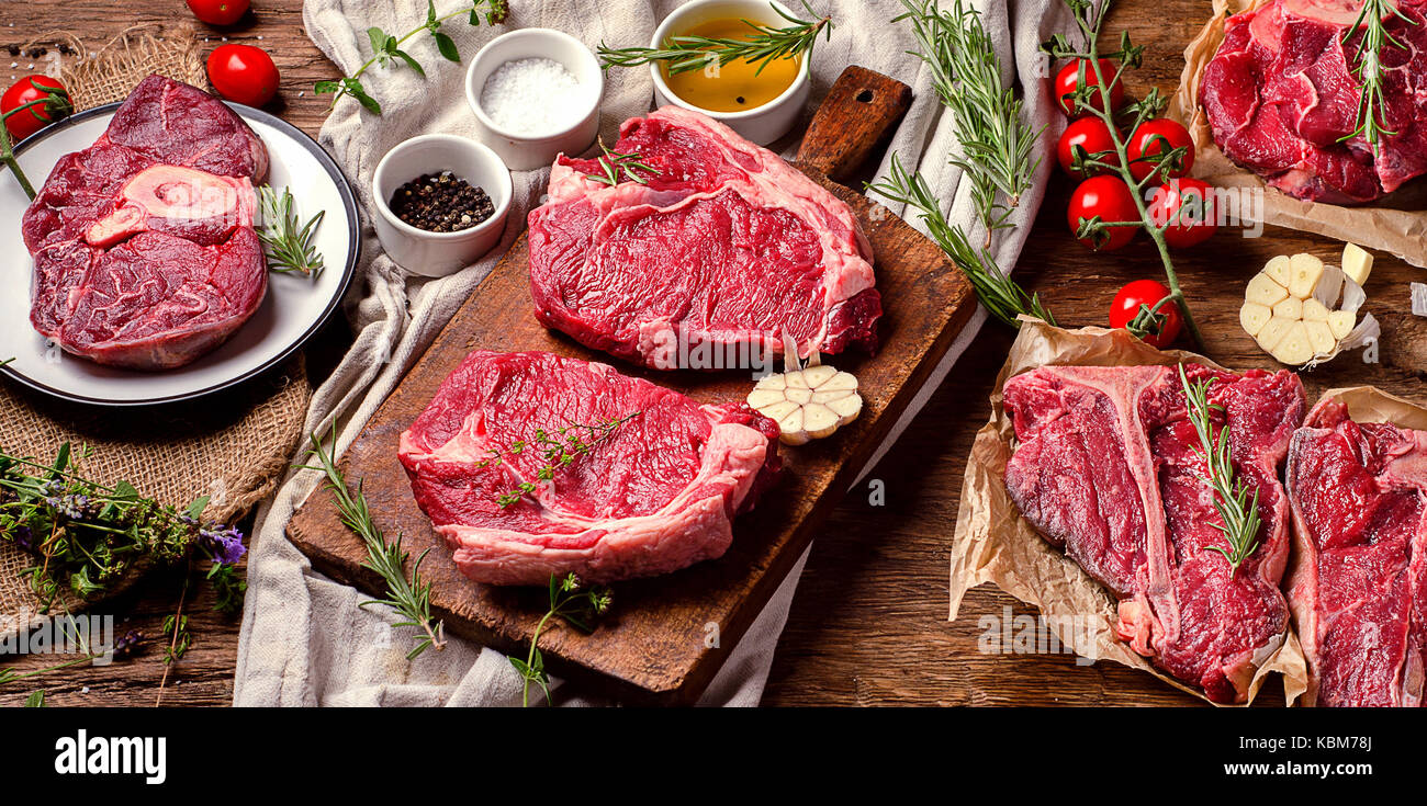 Raw beef meat on a dark wooden board. Top view Stock Photo