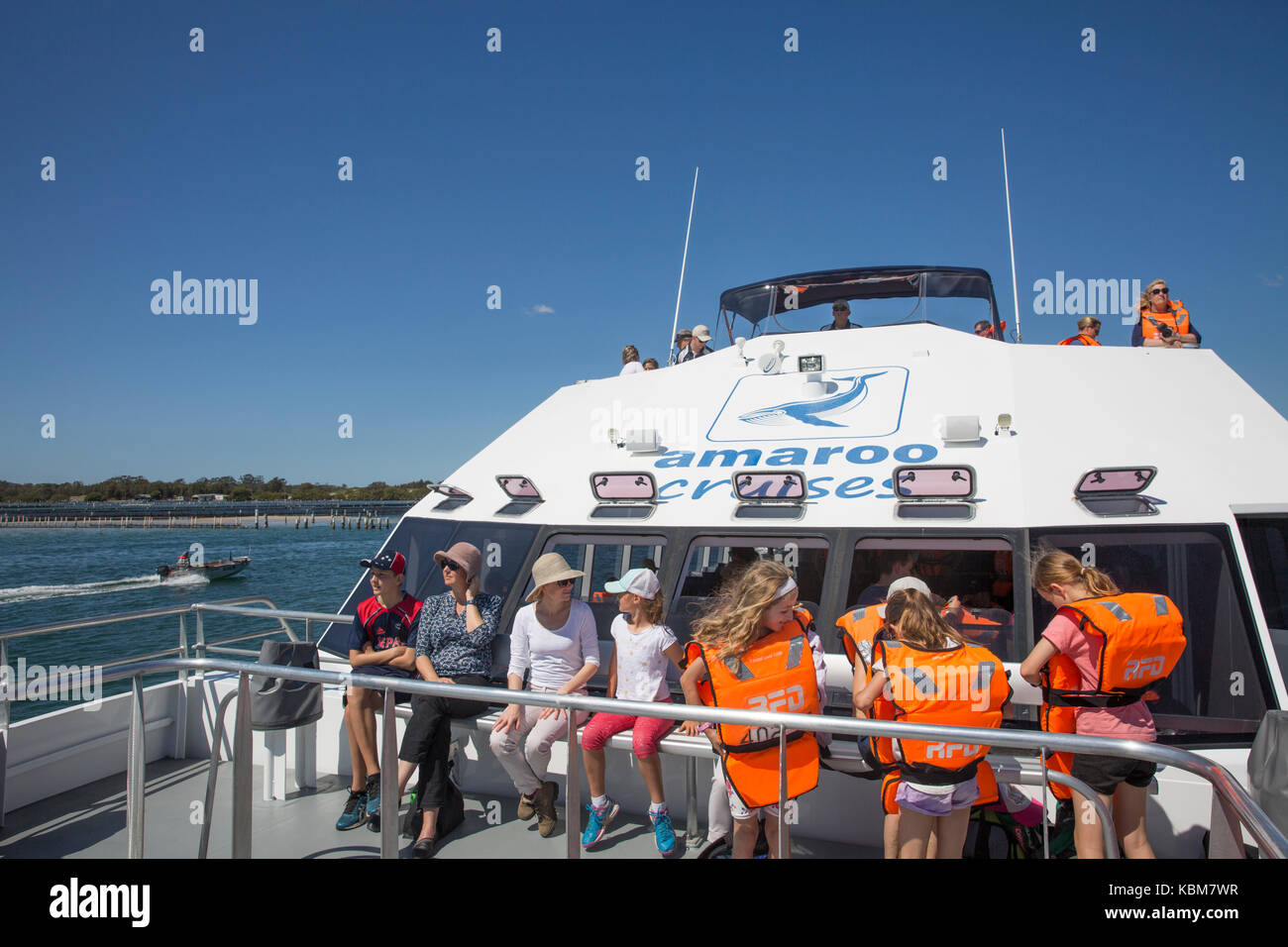 Adults and children on Amaroo cruises vessel heading out for whale watching tour at Forster, new south wales,australia - Stock Image