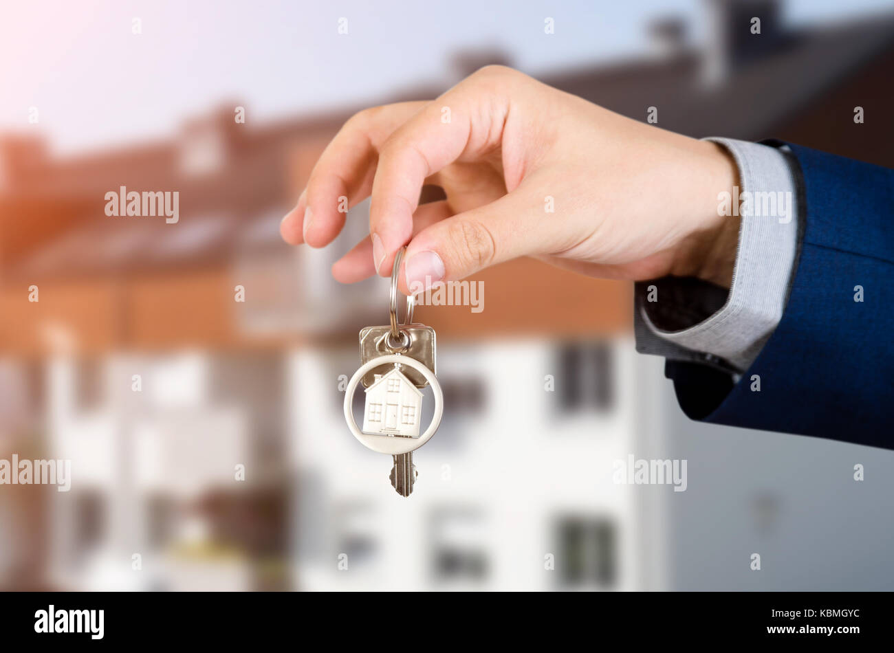Real estate agent with home keys. realestate key apartment real estate home homeowner starts concept - Stock Image
