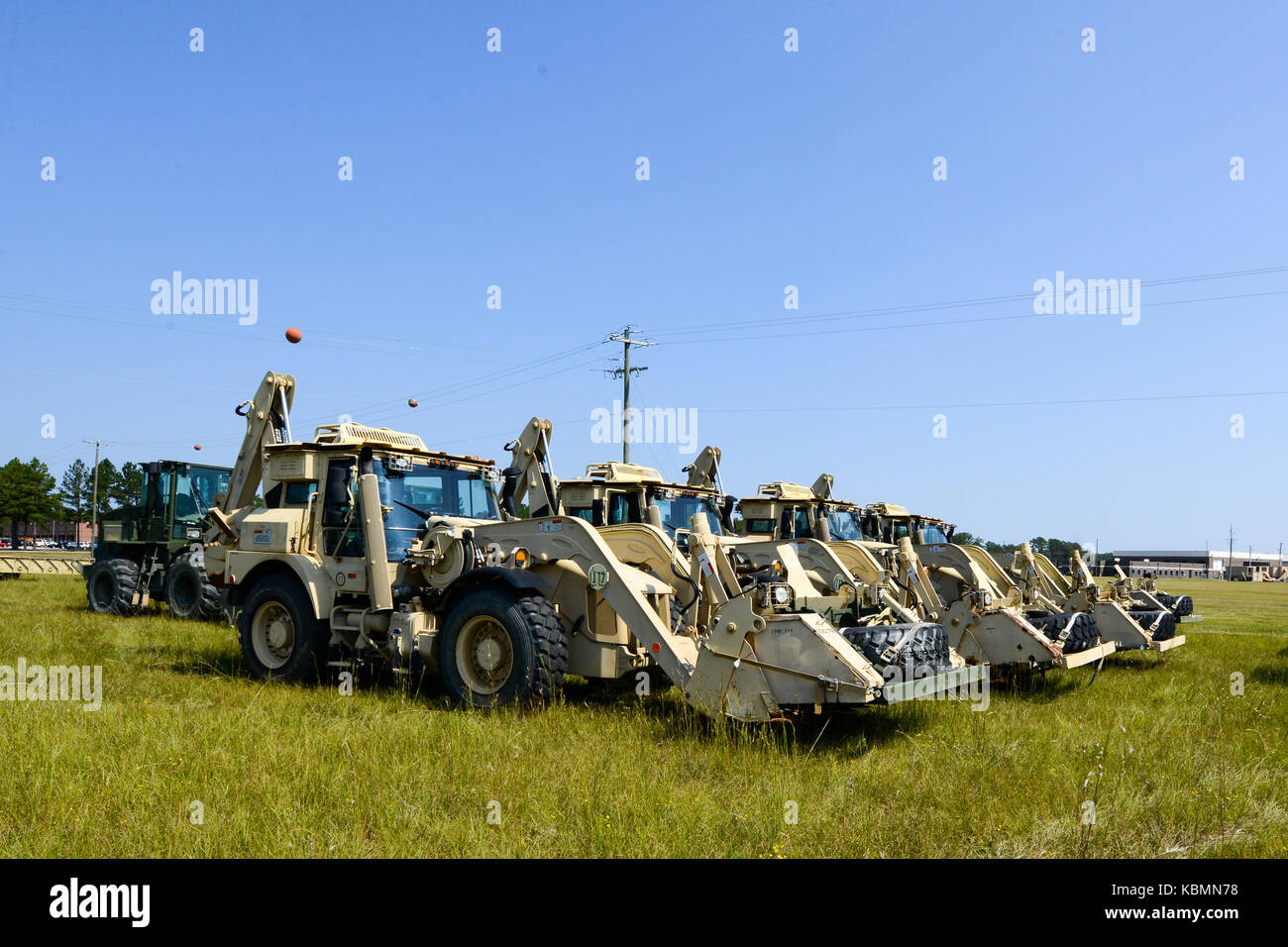 U.S. Soldiers assigned to the 178th Engineer Battalion, South Carolina Army National Guard, stage heavy equipment Stock Photo
