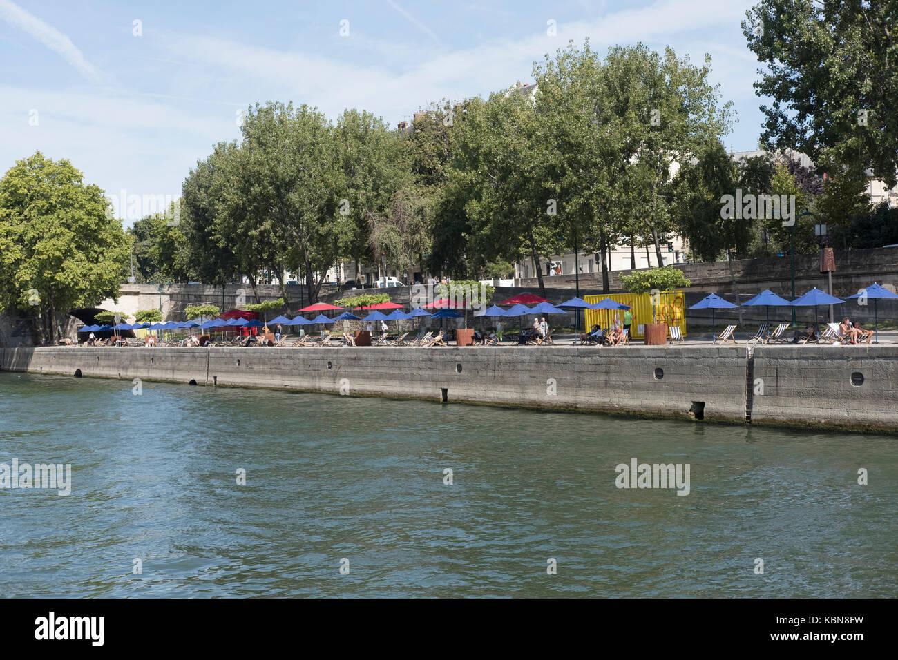 Sunbathing by  the Seine Paris - Stock Image