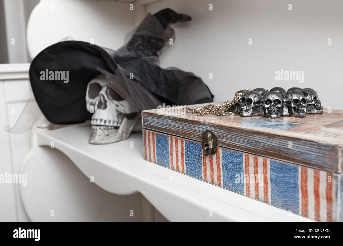Human skull in a white cabinet. Halloween theme Stock Photo