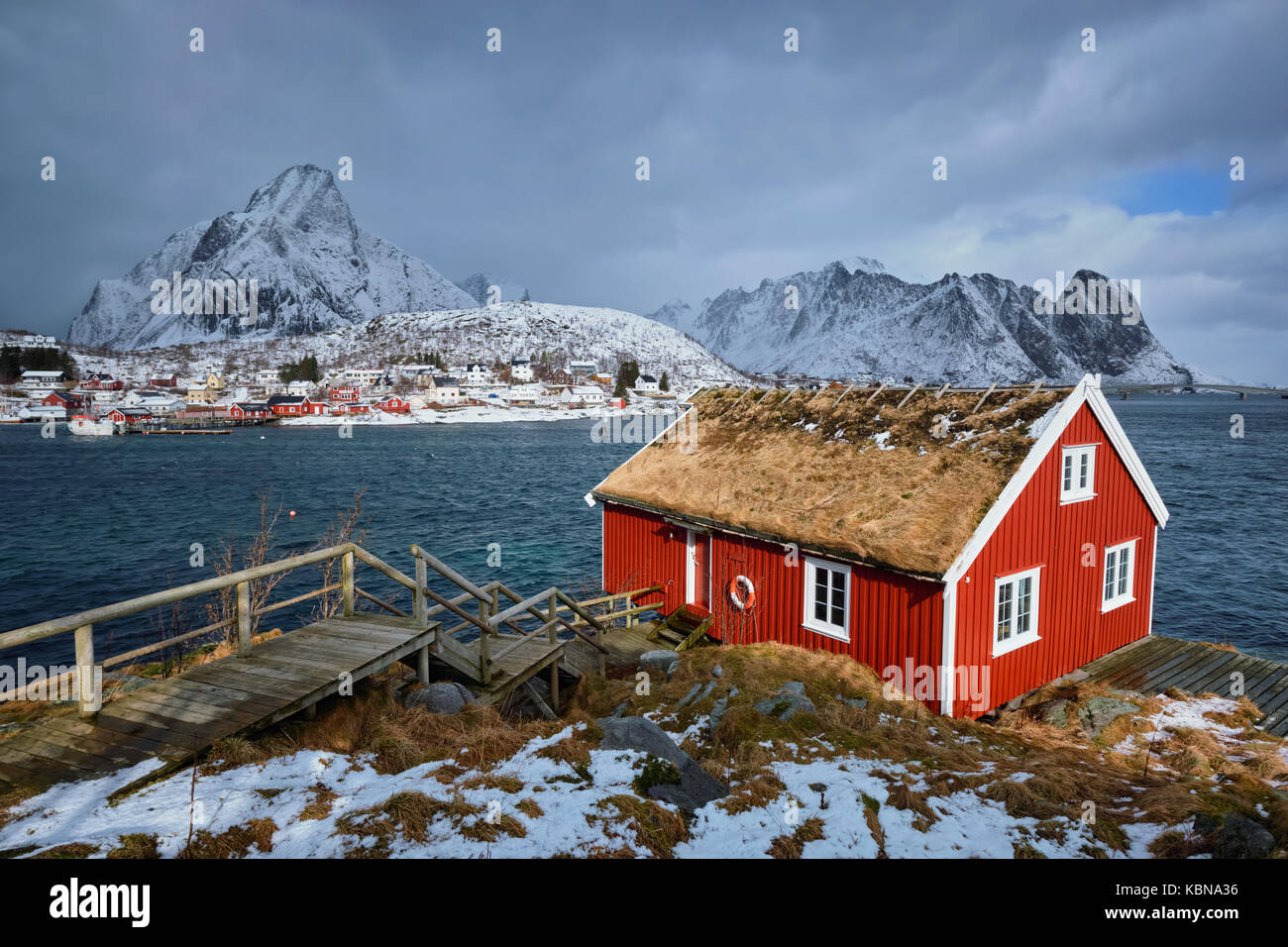 Traditional red rorbu house in Reine village on Lofoten Islands, - Stock Image