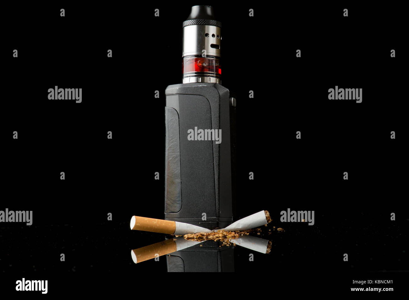 Modern vaporiser versus old tobacco cigarette Stock Photo