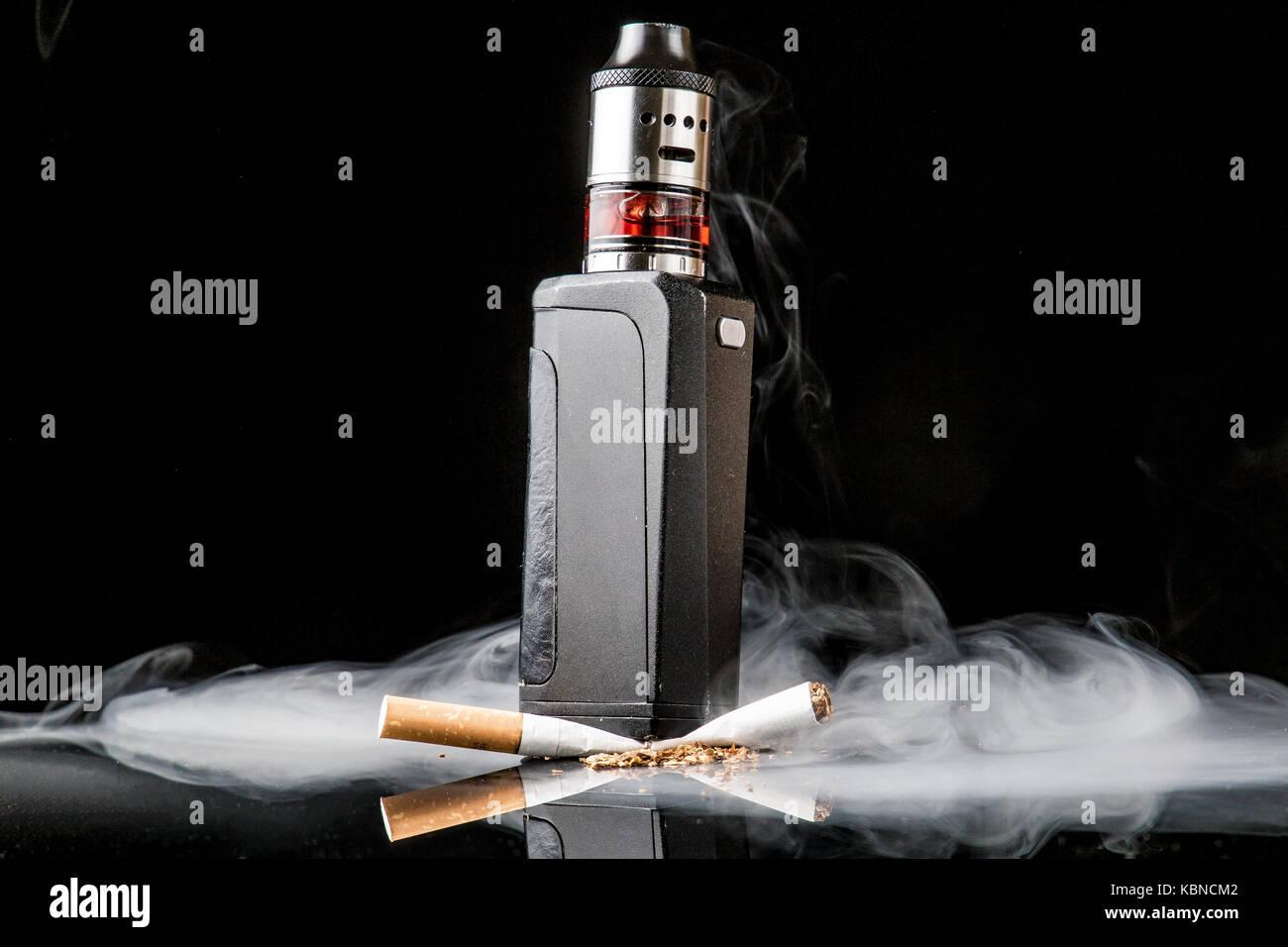 Modern vaporiser versus old tobacco cigarette Stock Photo