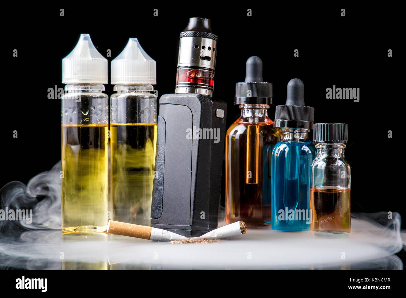 Modern vaporiser versus old tobacco cigarette in smoke Stock Photo