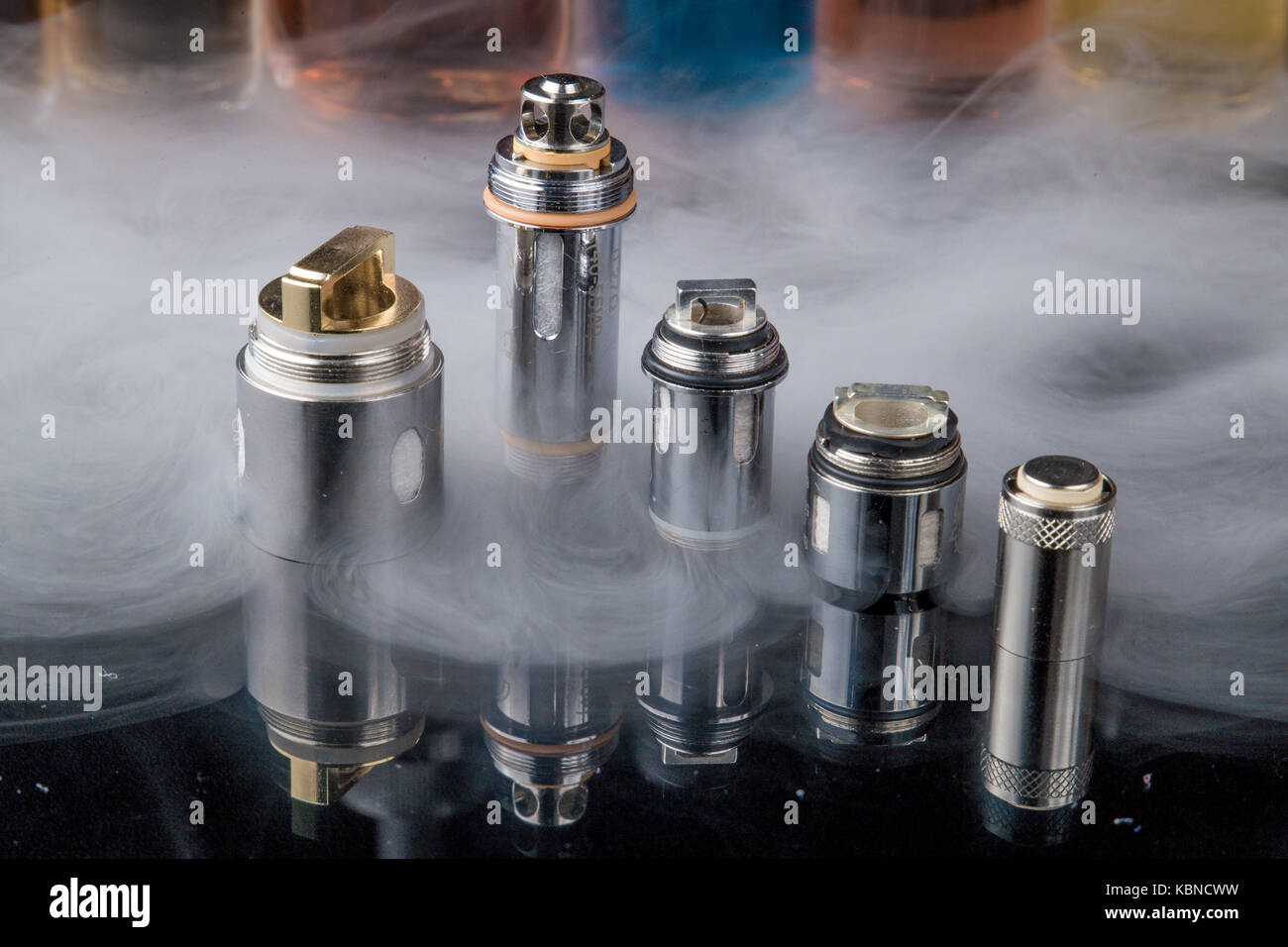 Electronic cigarette Clearomizer coils in smoke cloud Stock Photo
