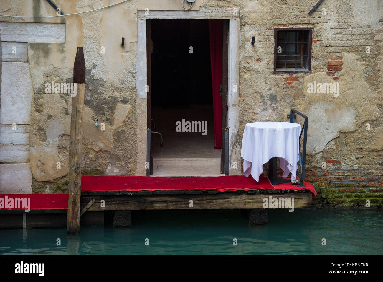 Dinner for none on a Venetian terrace - Stock Image