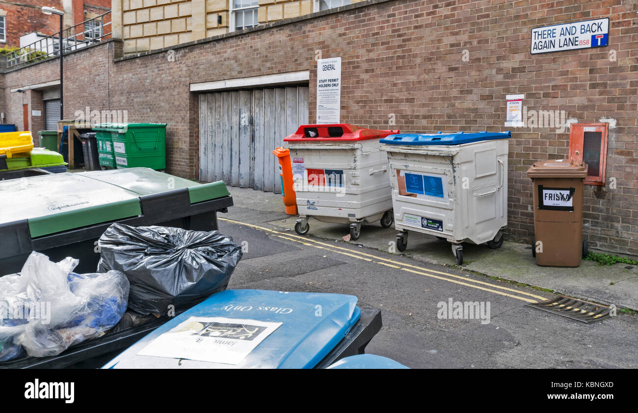 BRISTOL ENGLAND CITY CENTRE THERE AND BACK AGAIN LANE CROWDED WITH RUBBISH BINS - Stock Image