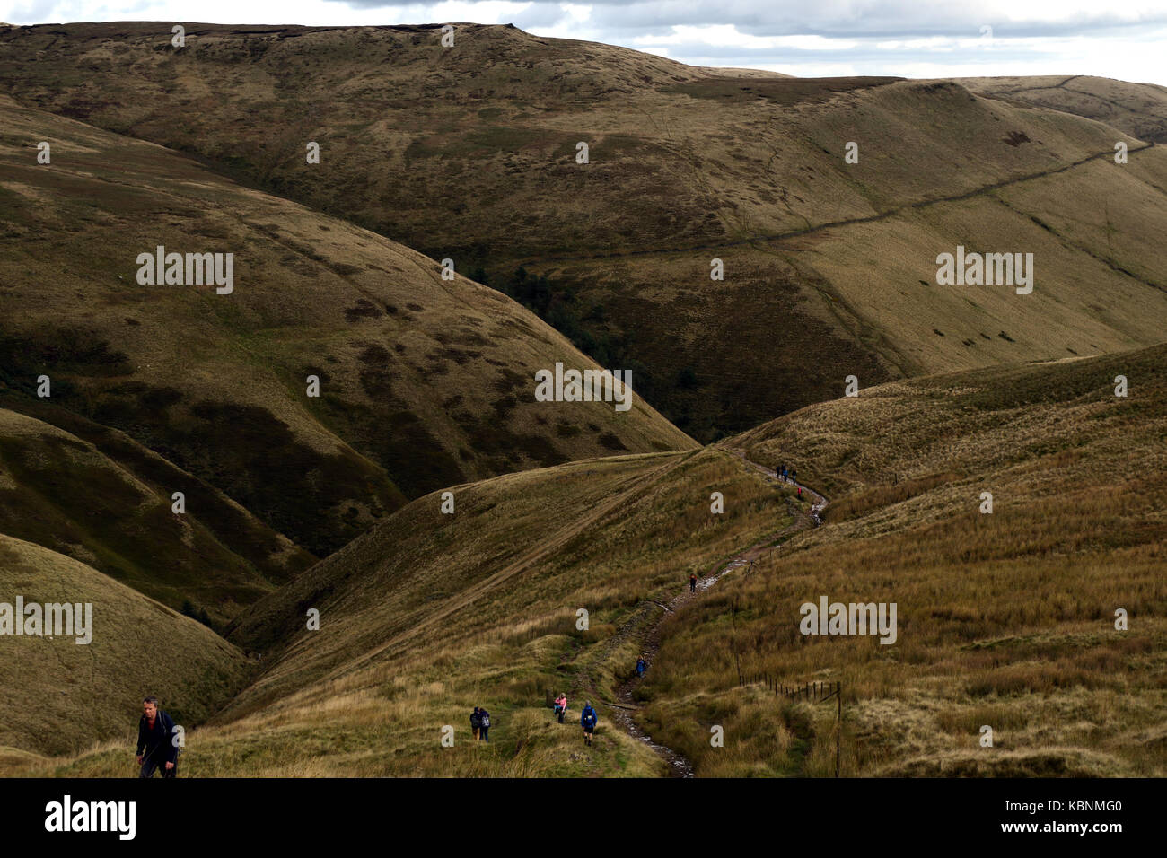 View back down the Pennine Way, towards Edale, from the climb up Kinder Scout - Stock Image