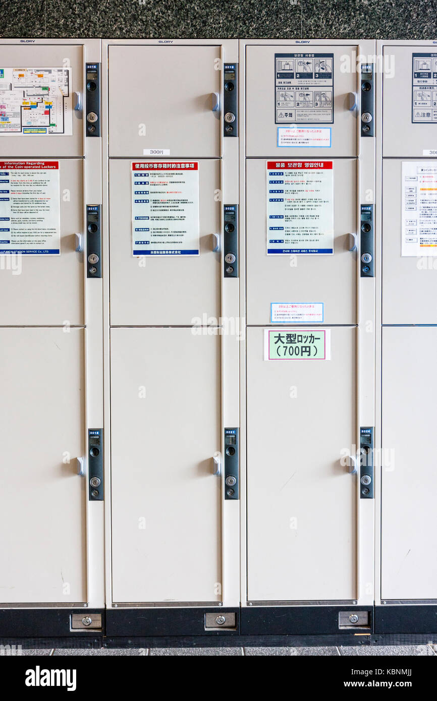 Japan, Kyoto. Kyoto station, three sizes of lockers stacked atop of each other. Largest at bottom, smallest at top. - Stock Image