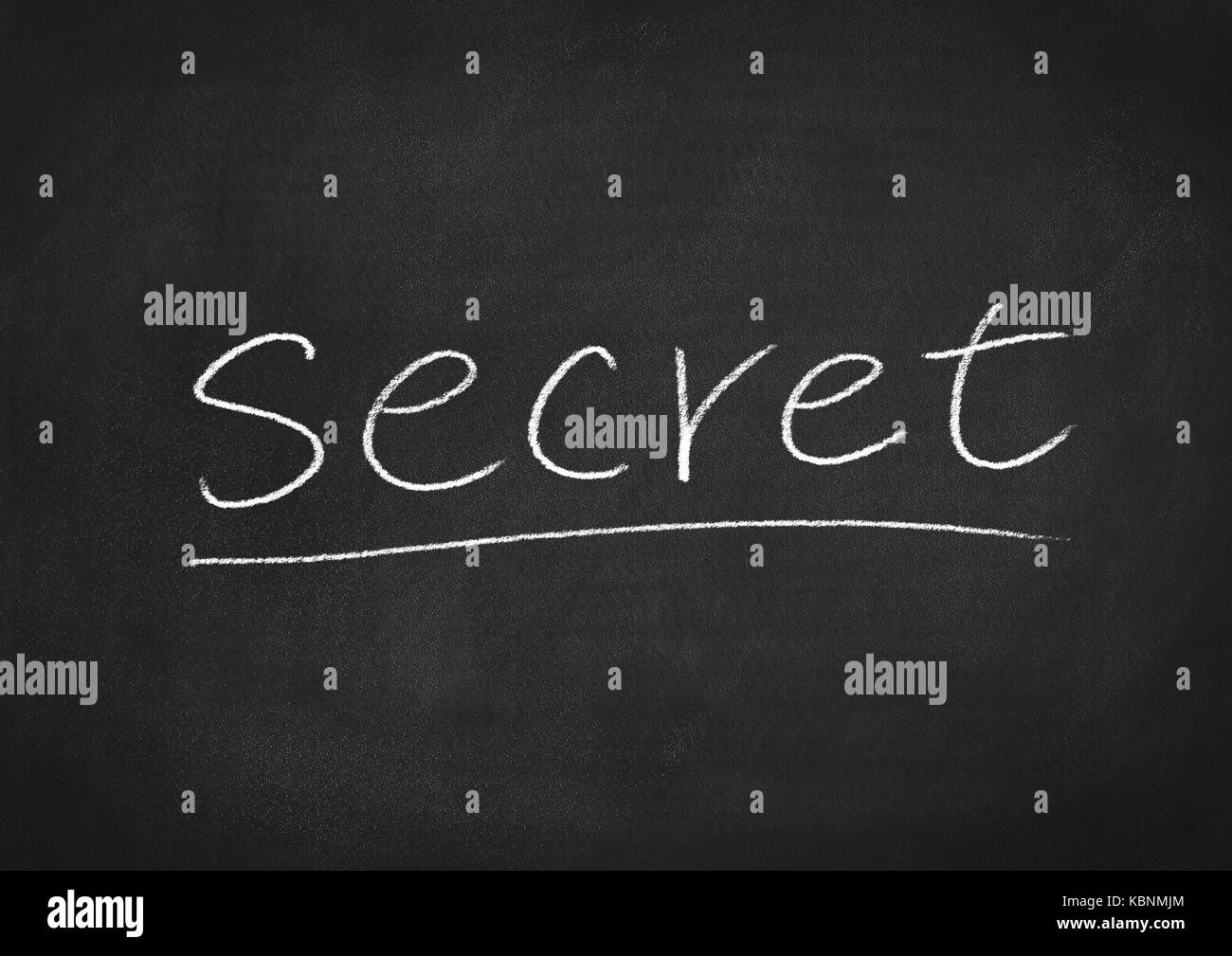 secret concept word on a chalkboard background - Stock Image