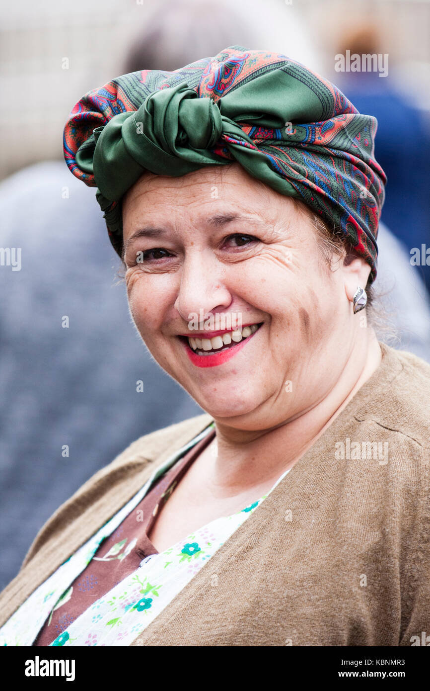 England, Chatham Dockyard event. Head shot of smiling woman dressed as typical world war two London middle-aged - Stock Image
