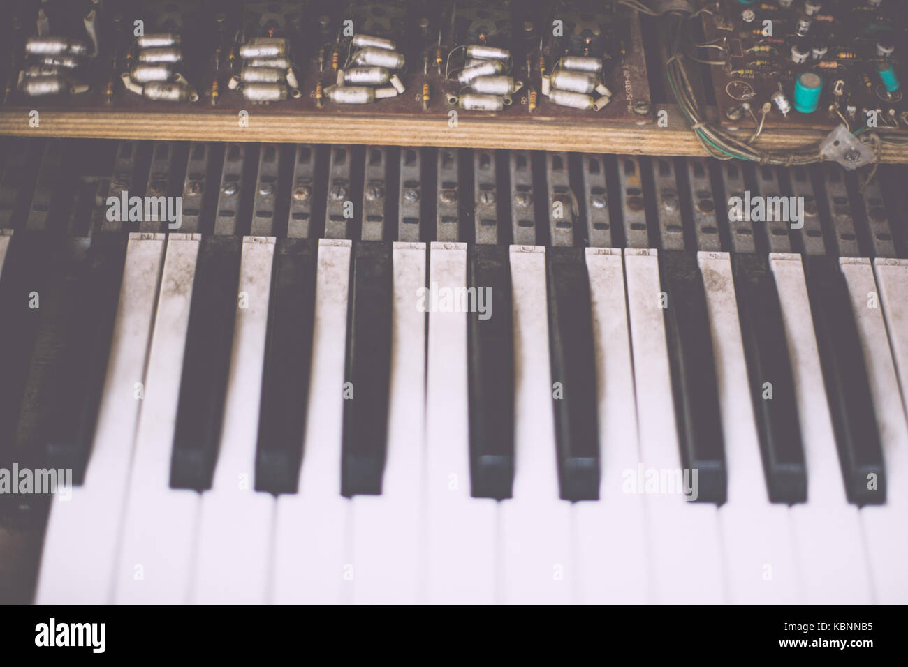 Old retro unnecessary faulty musical synthesizer - Stock Image