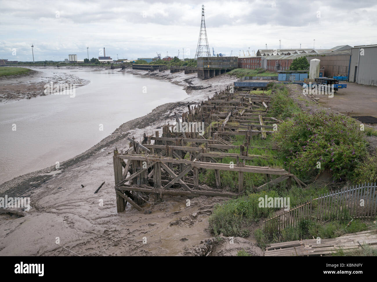 View from Newport Transporter Bridge downstream along lower reaches of River Usk with disused and rotting wooden - Stock Image