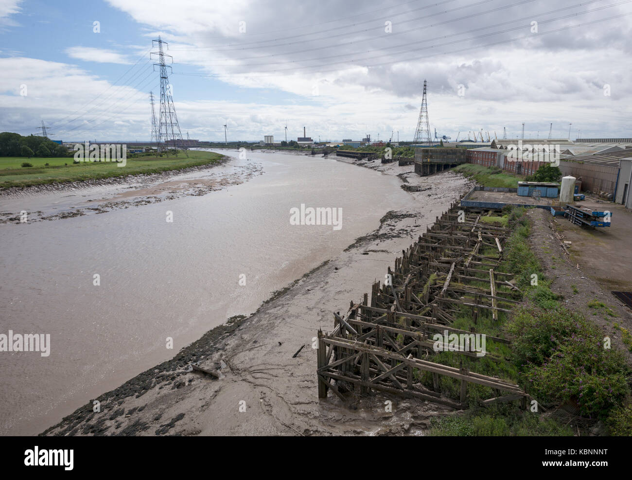 View from upper deck of Newport Transporter Bridge along lower reaches of River Usk with disused and rotting wooden - Stock Image