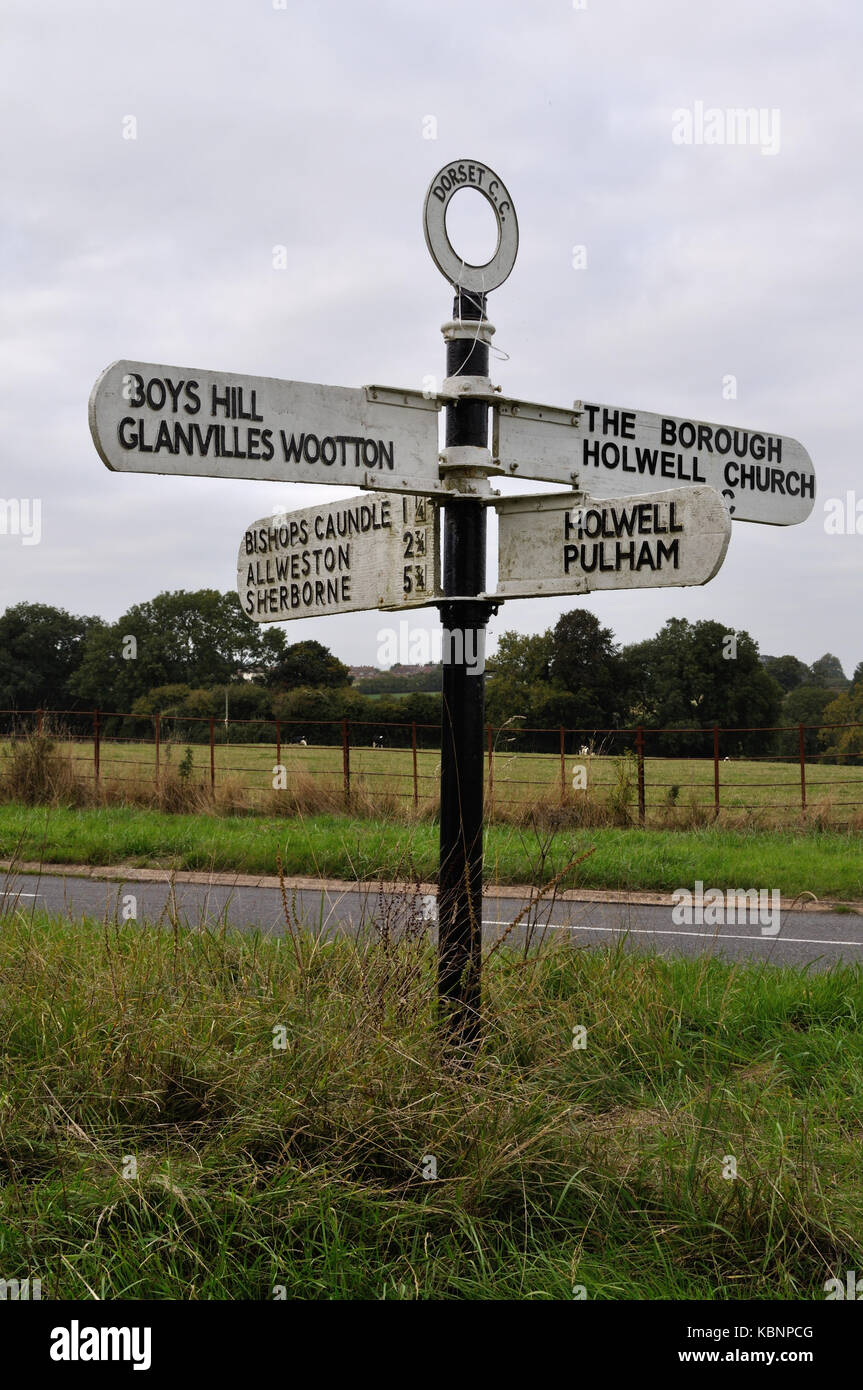 Traditional finger post direction sign at Holwell, near Sherborne, Dorset. Unlike many such signs in Dorset, this - Stock Image