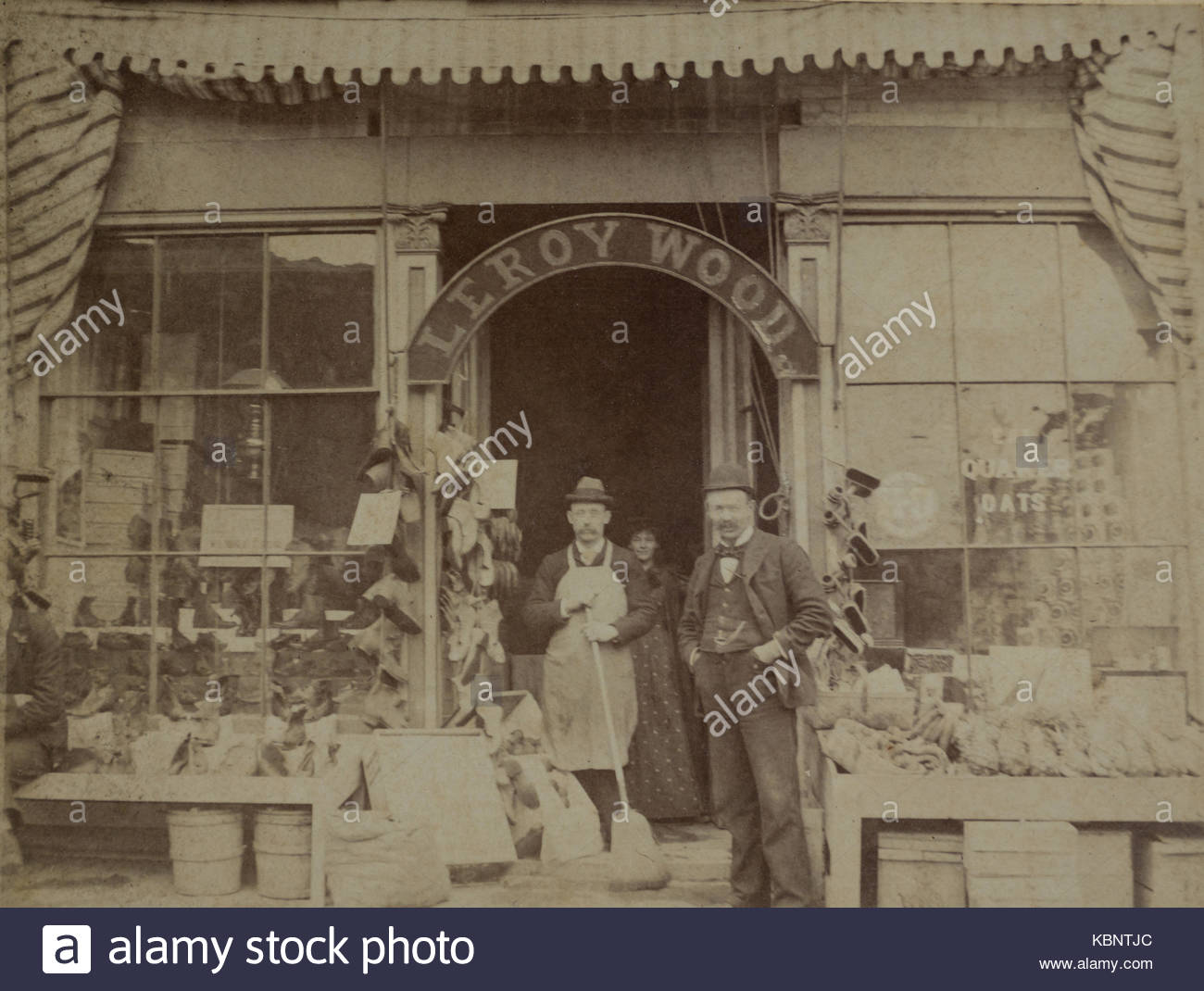 American archive monochrome photo of grocer Shop or General Store front with an arched sign with name Leroy Wood - Stock Image
