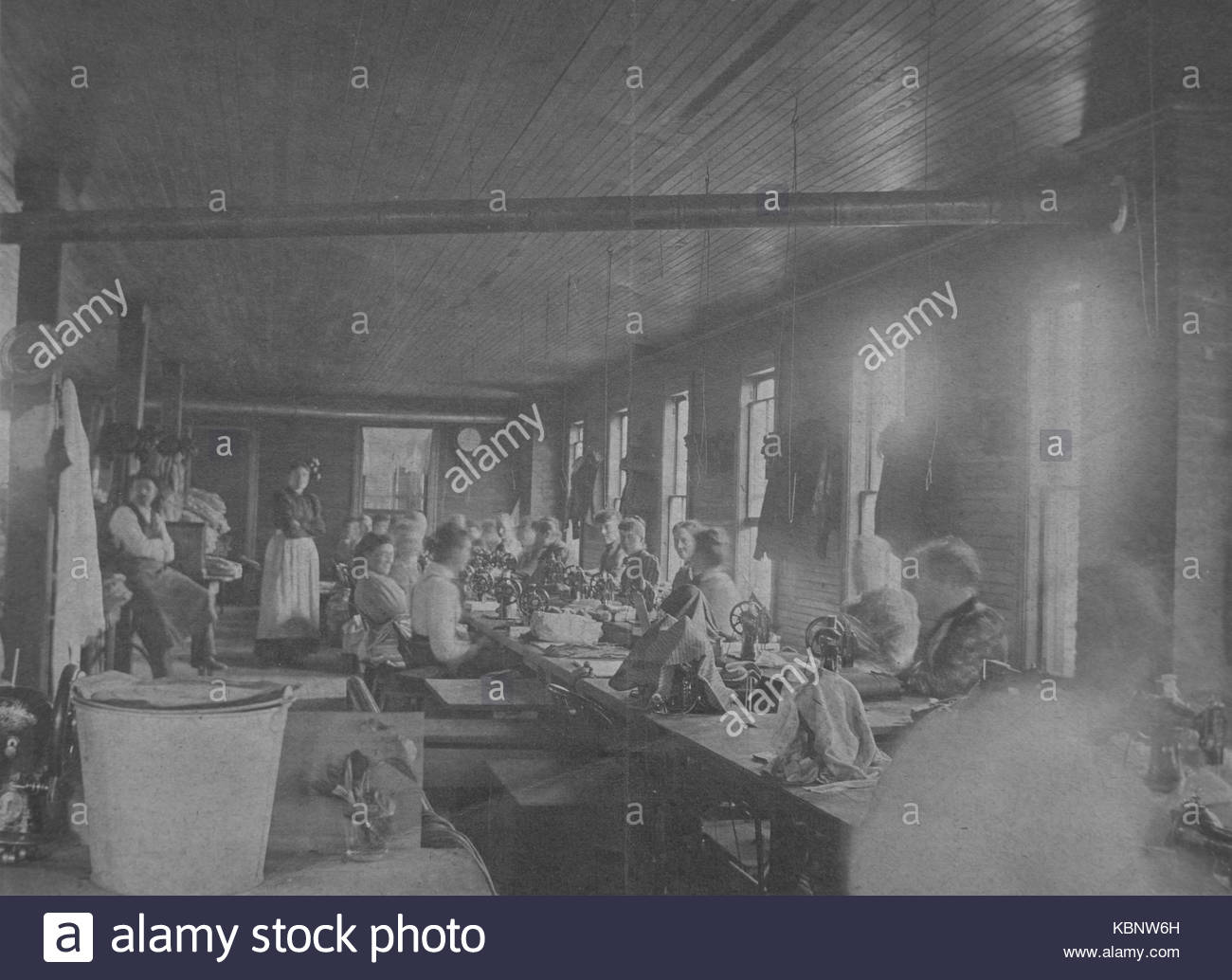 American archive monochrome black and white version of a Cyanotype photograph of employees or workers in the Sewing Stock Photo